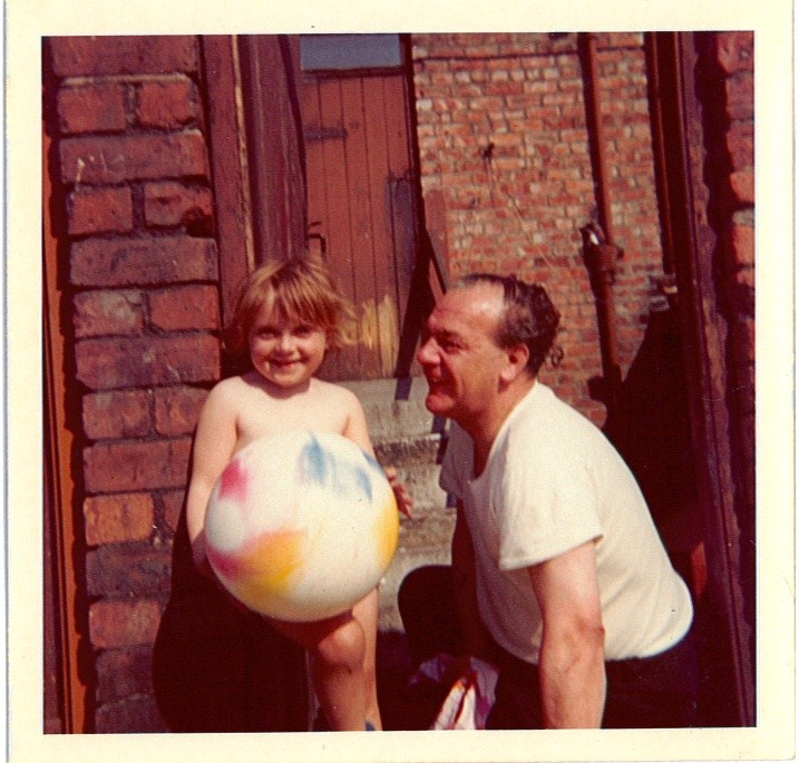 Me and my Uncle Sid on a sunny day in the back lane - look at the scrapes on my knees from shinning up the walls!