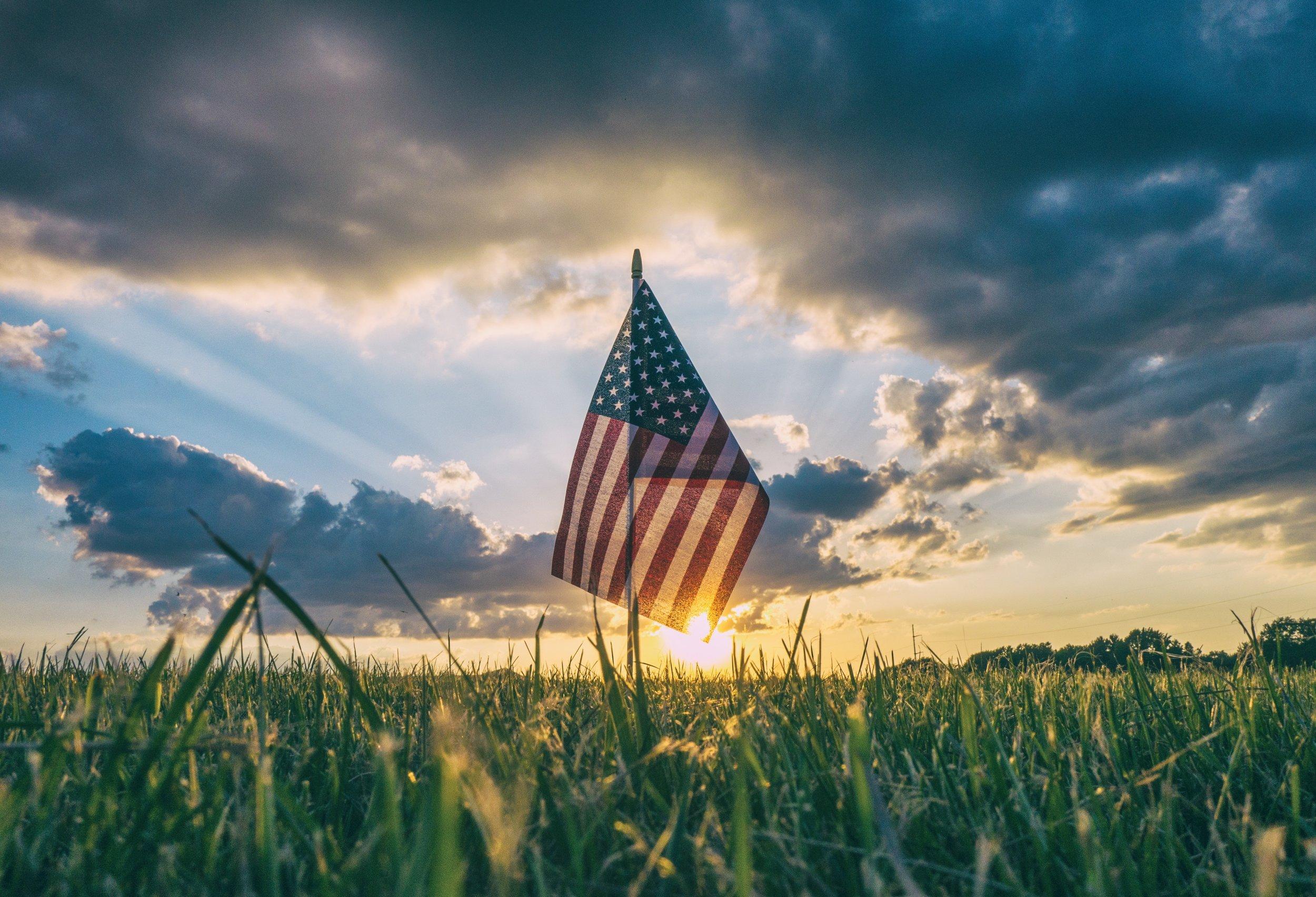 American Flag in a grassy field