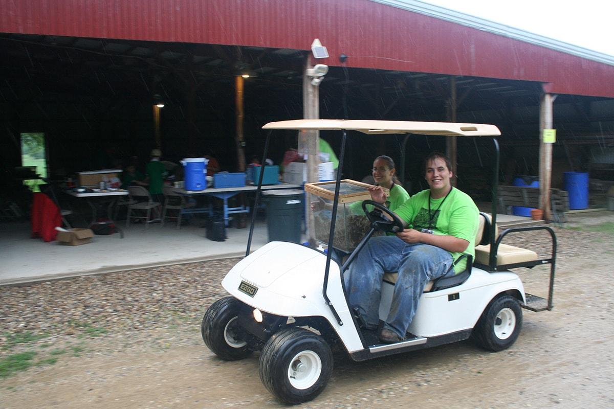 volunteers-golf-cart-art-science-woods-min.jpg