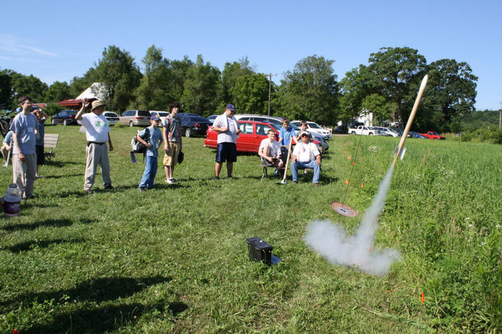 Students watch a rocket launch at Art and Science in the Woods