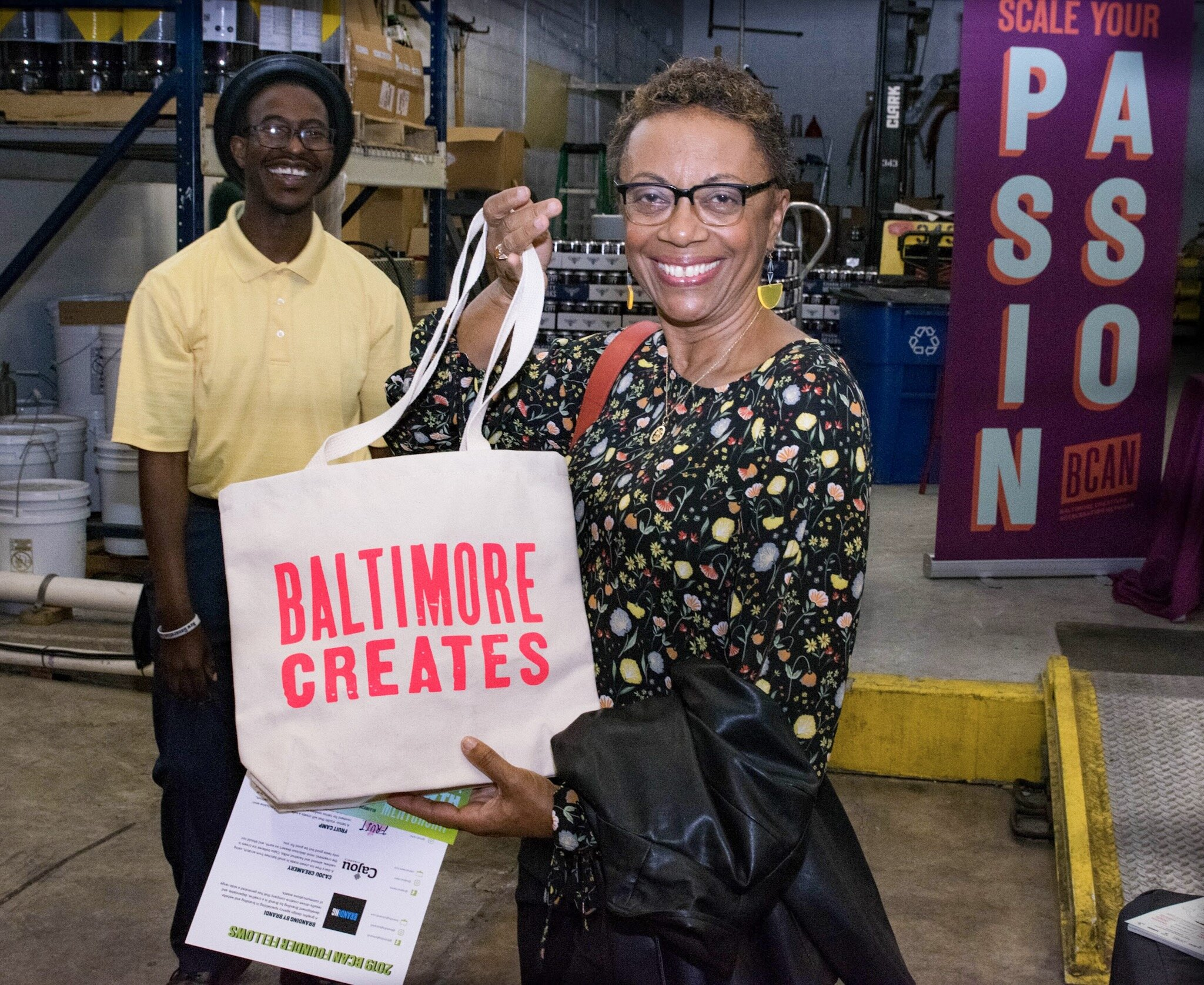 """BCAN Founder Fellowship Course Coordinator Joe Tynes and along with the winner of our """"Baltimore Creates"""" tote bag"""