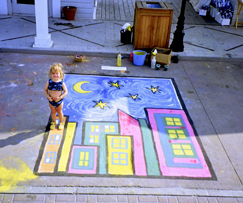 Andy's second time to participate. He was sponsored by Hawkins & Arnold art gallery again. Here's our daughter Taylor (age 2) posing with Andy's painting, which wasn't quite finished. (Seaside – April 1999)