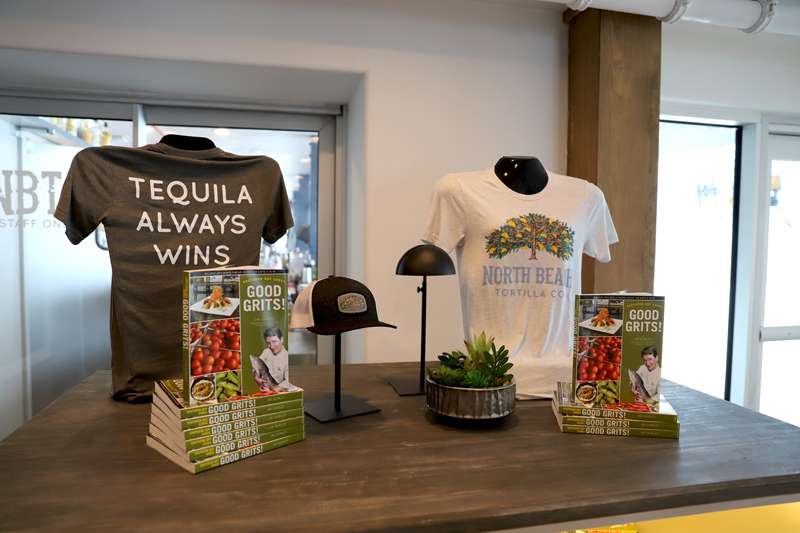 Andy's taco tree appears on t-shirts and hats, which can be purchased along with Jim's cookbook.