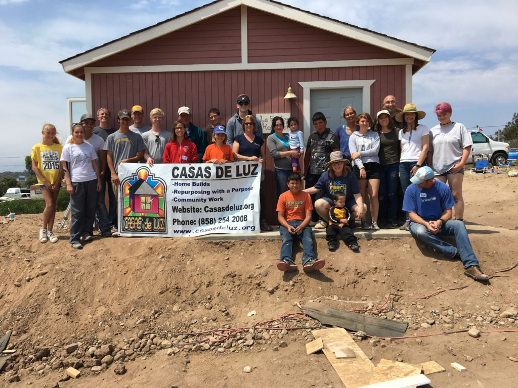 Volunteers outside a finished home build.