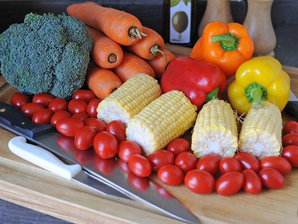Healthy vegetables on a cutting board.