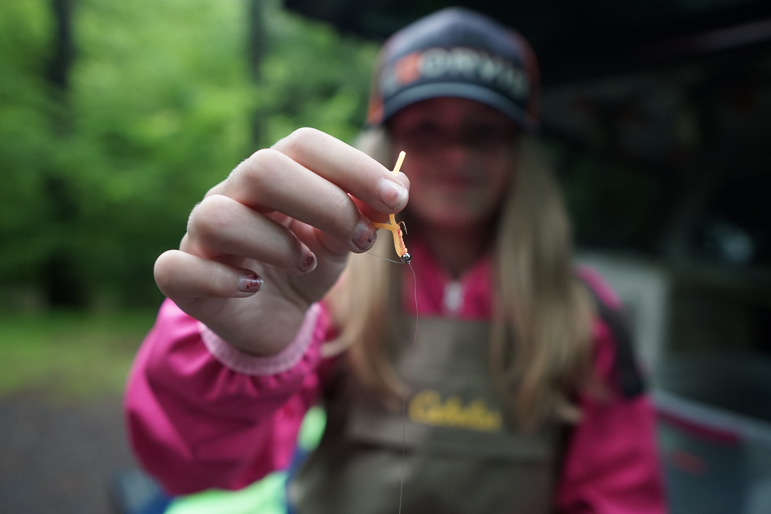Evangeline Daniel Shows off a bright orange squirmy she tied the night before. She followed a simple rule to catch fish in high water-set the hook when the bright orange fly DISAPPEARS.
