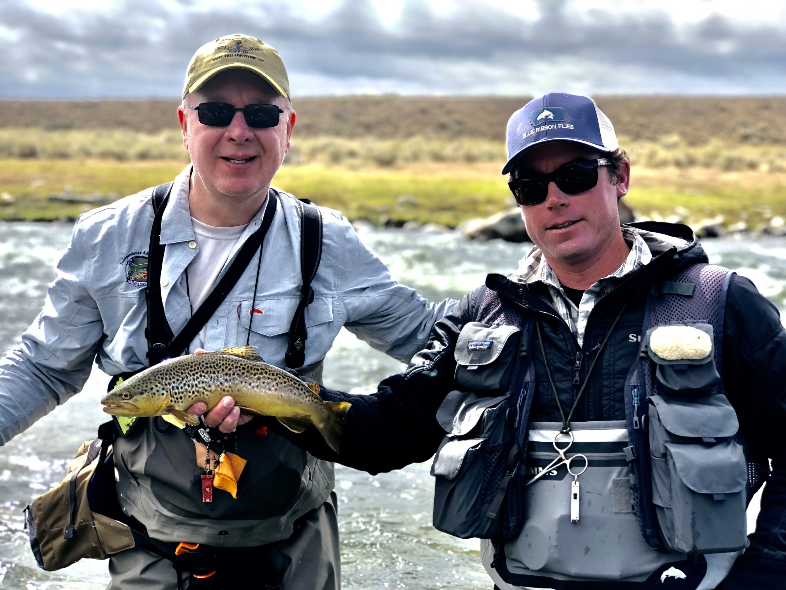Blue Ribbon Guide Drew Mentzer holds up a quality brown trout taken on an Arrick's Ant by Charles Boinske.