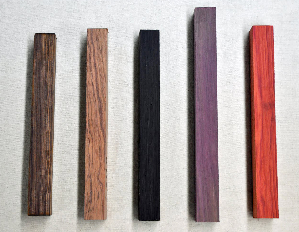 (left to right) Cocobolo, Honduran Rosewood, African Blackwood, Purple Heart, Bloodwood