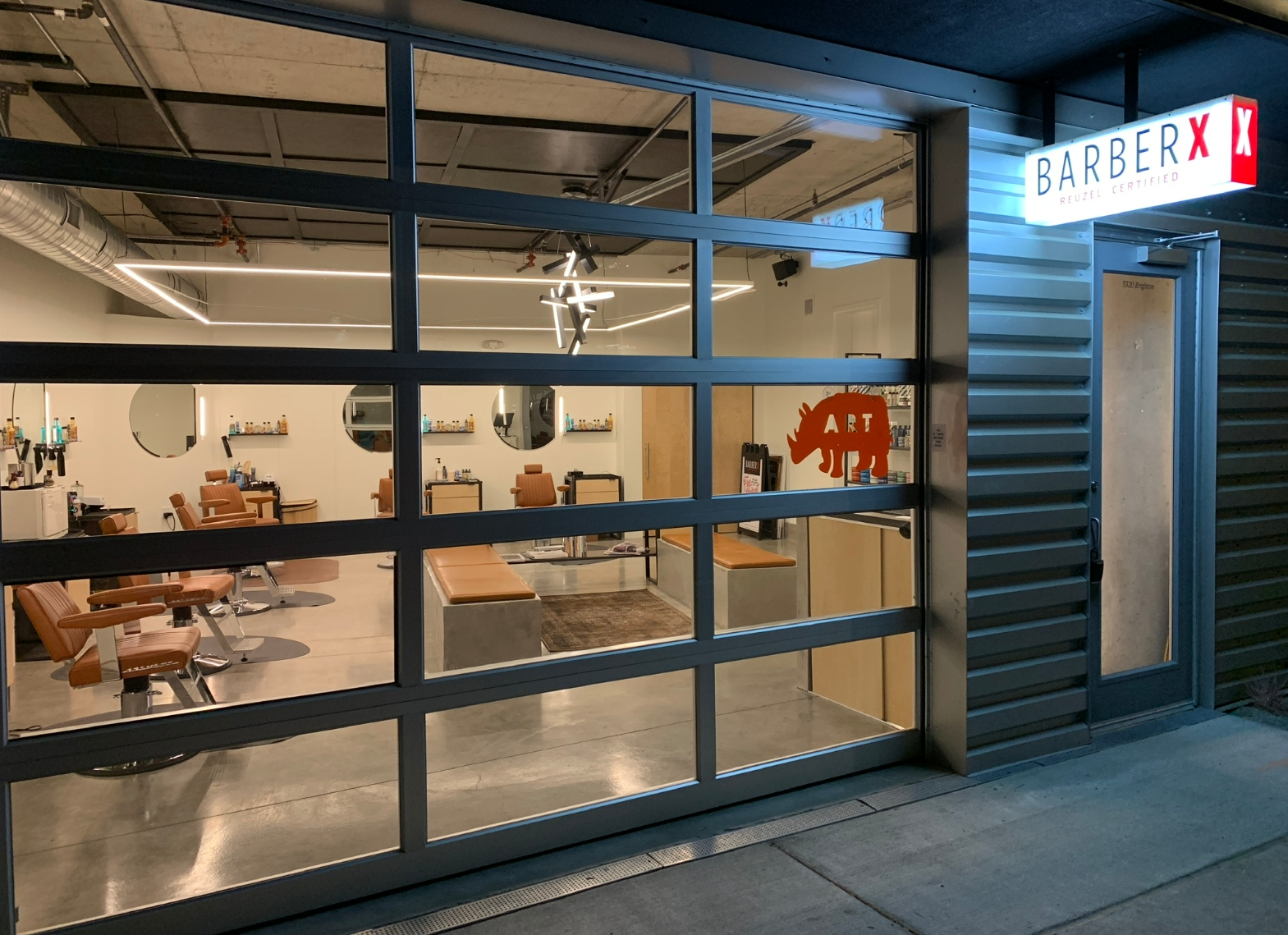 We are a six-chair barbershop. A barbershop with a glass garage door that opens up when weather allows.