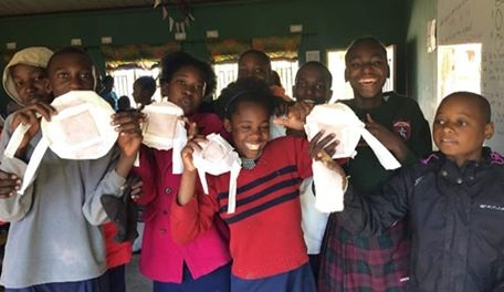 SKIP Cardiff beneficiaries with their Project Mwezi sanitary pads that they have just learnt how to make
