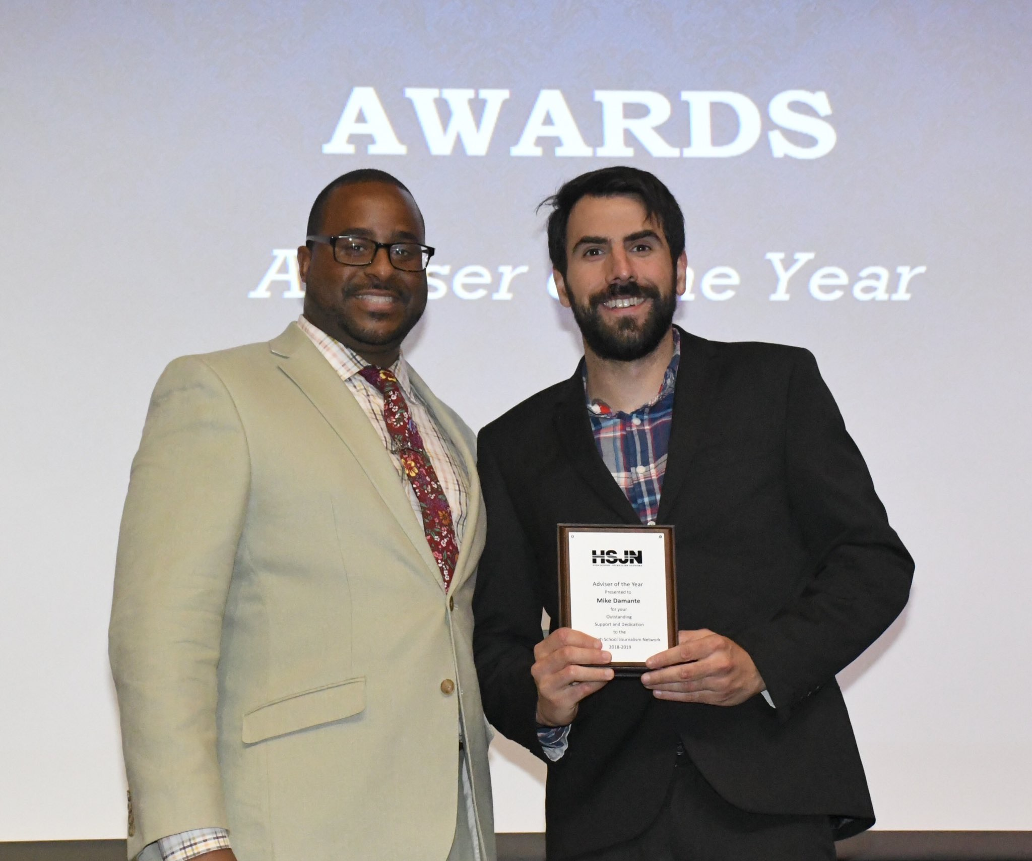 Angel Verdejo presents Michael Damante with adviser of the year award. (Joel Weckerly)