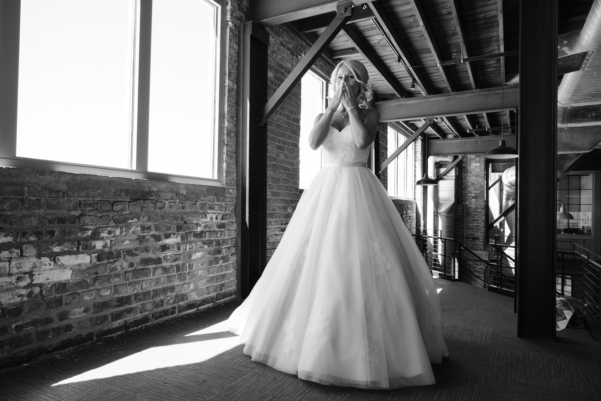 Bride smiling while walking up to groom for first look at PSB in Rockford Illinois.