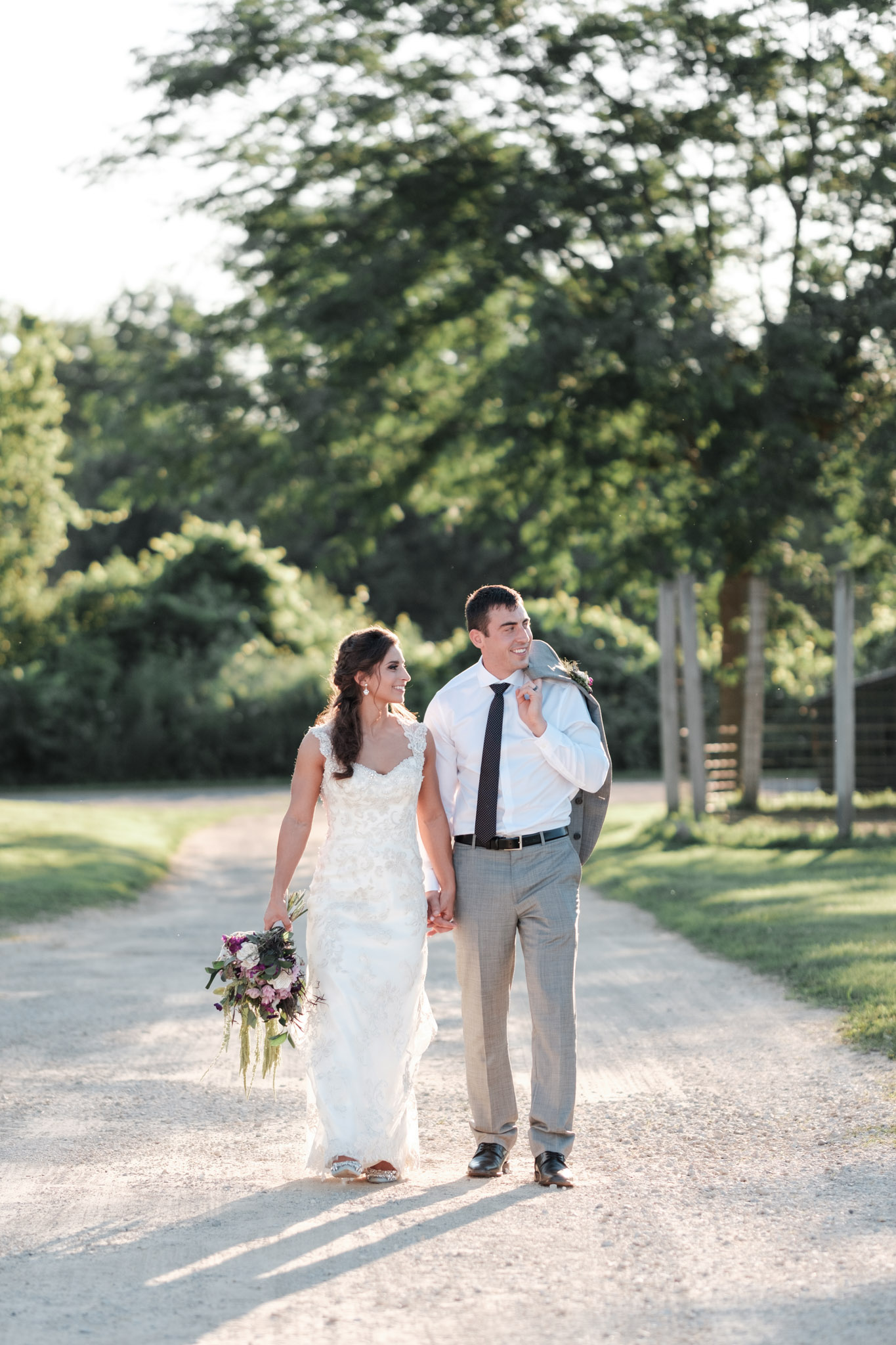 Golden hour portrait of couple at williams tree farm following their outdoor wedding.
