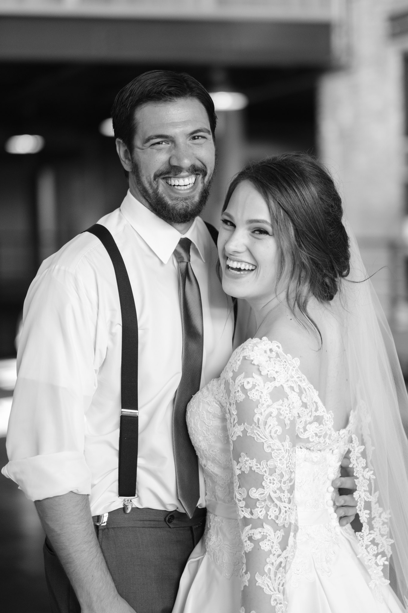 Couple embracing on their wedding day at Prairie Street Brewhouse entryway in Rockford, Illinois