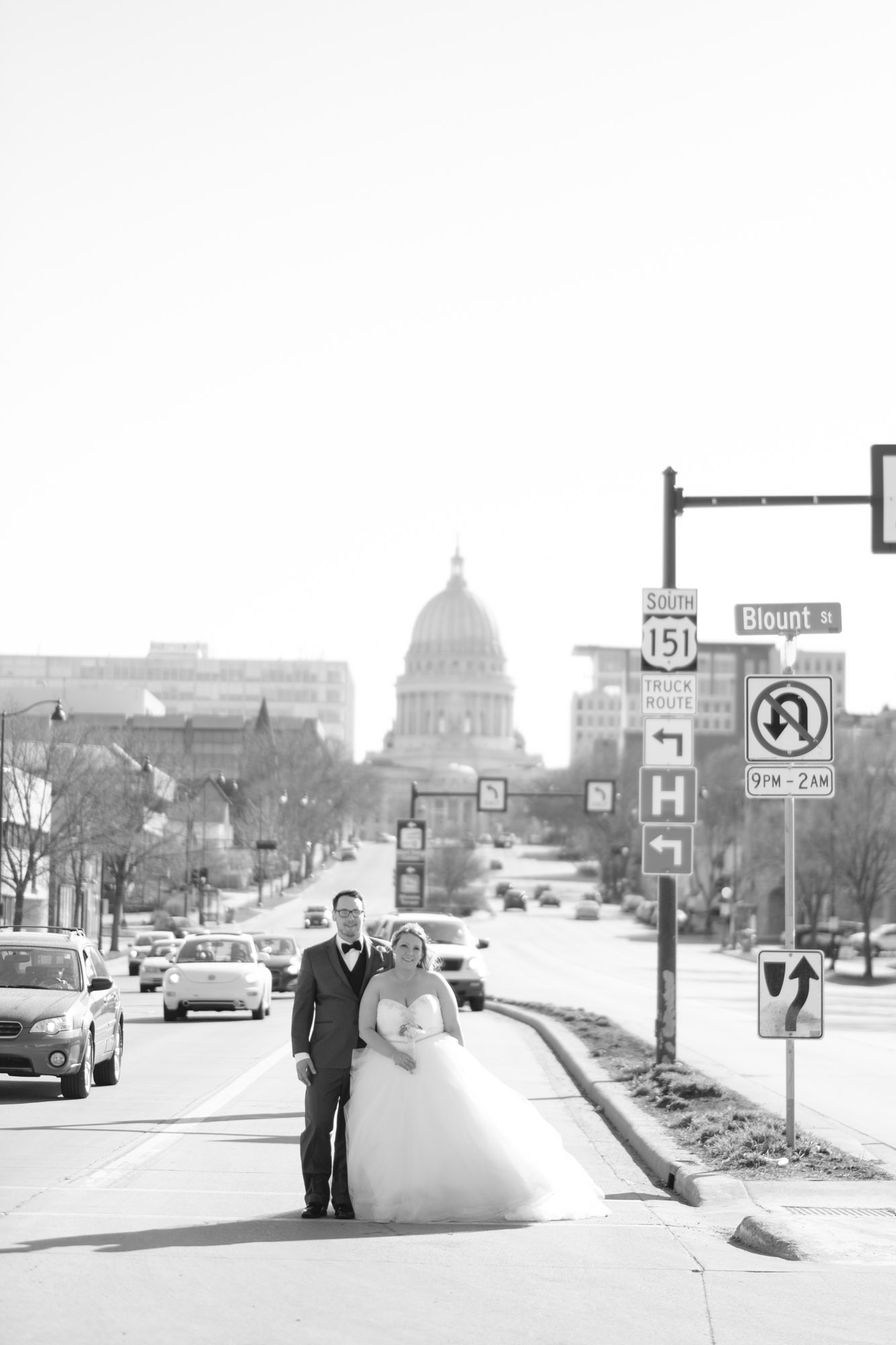 Bride and Groom standing in front of the Capitol Building in downtown Madison Wisconsin wedding