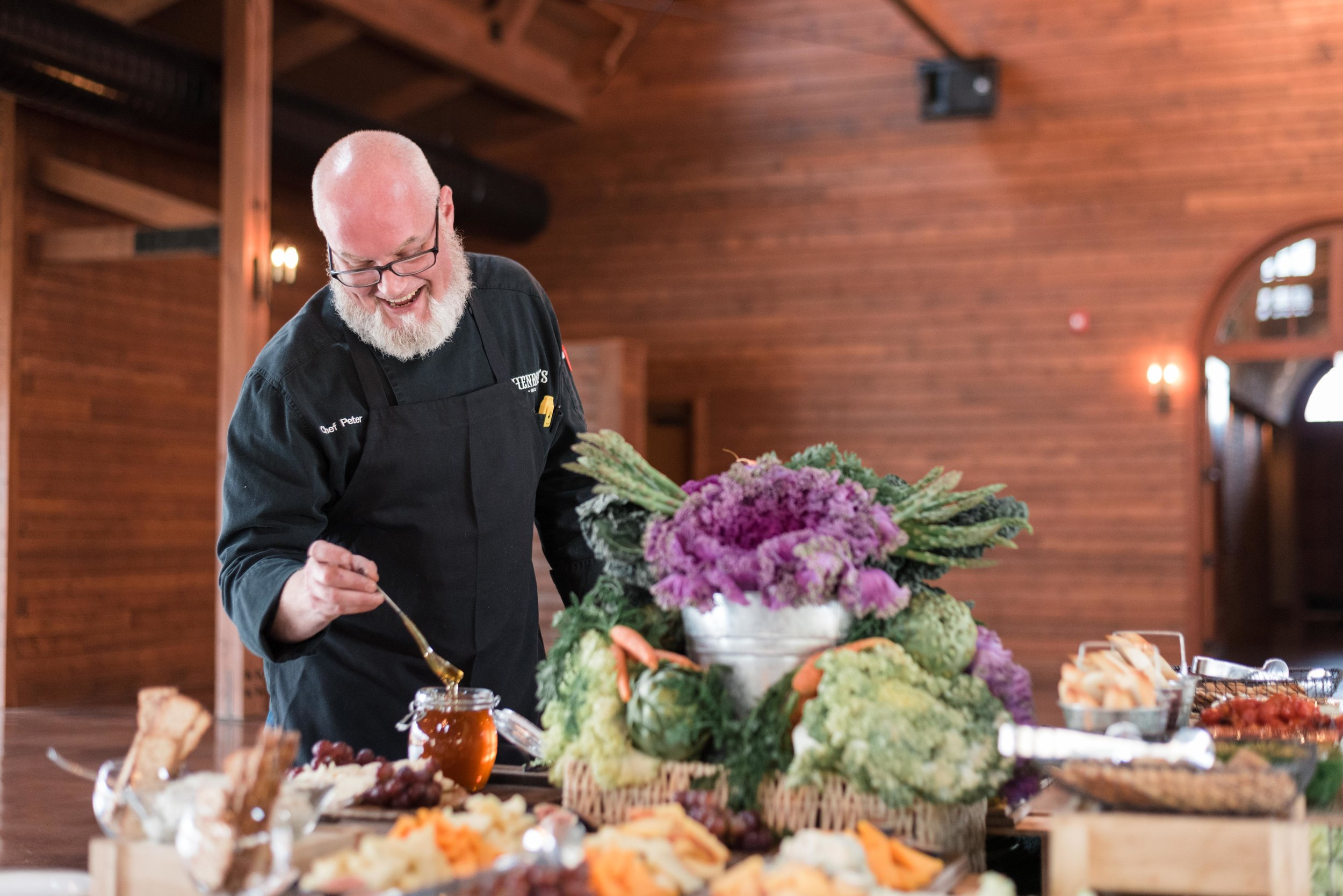 One of Henrici's Catering chefs prepares and serves the food to guests at The pavilion at Orchard Ridge Farms