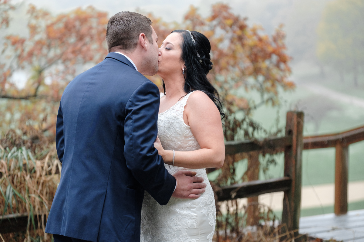 bride and groom kissing during first look at grand geneva resort in lake geneva wisconsin