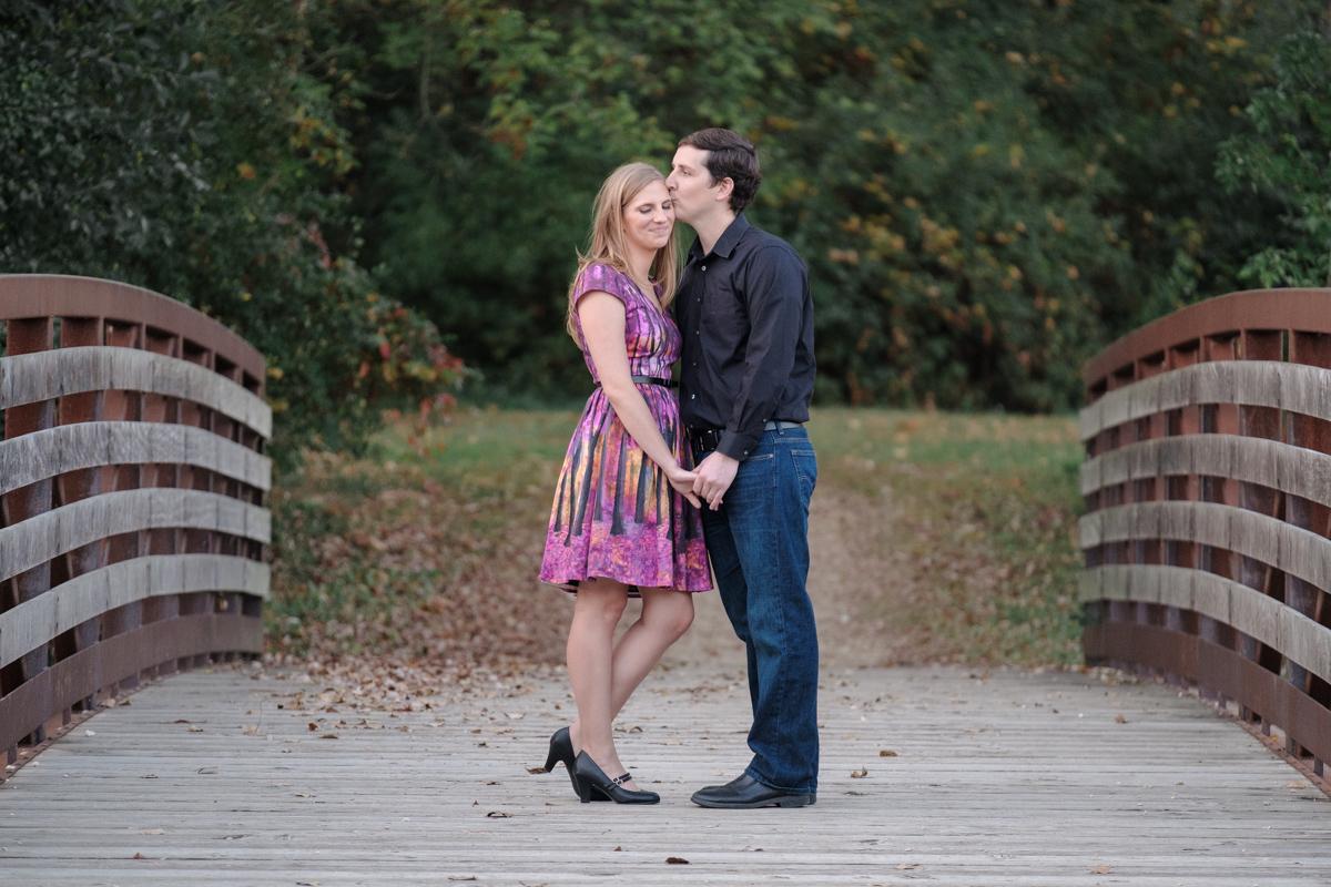 couple kissing on bridge at rock cut state park