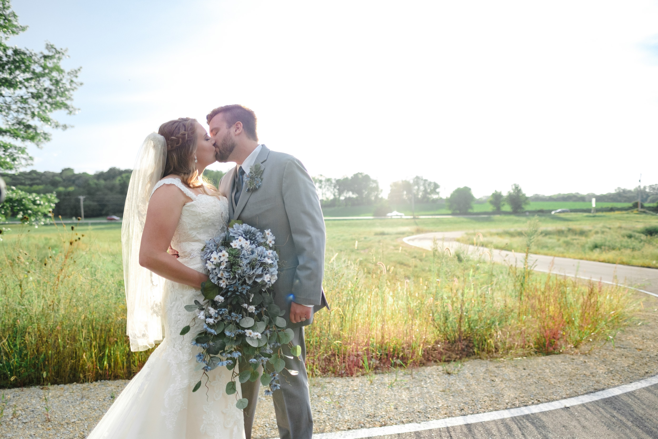 Bride and Groom kiss at The Fields Reserve in Stoughton, Wisconsin after their wedding ceremony