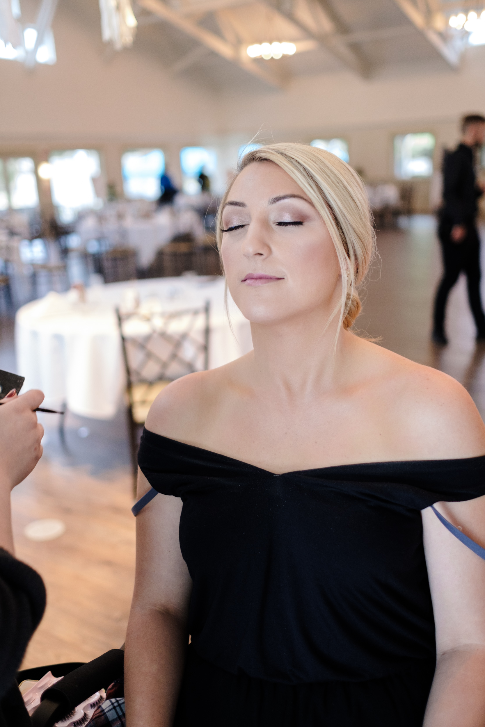 Blonde bride having makeup at Rockford Bank and Trust Pavilion.