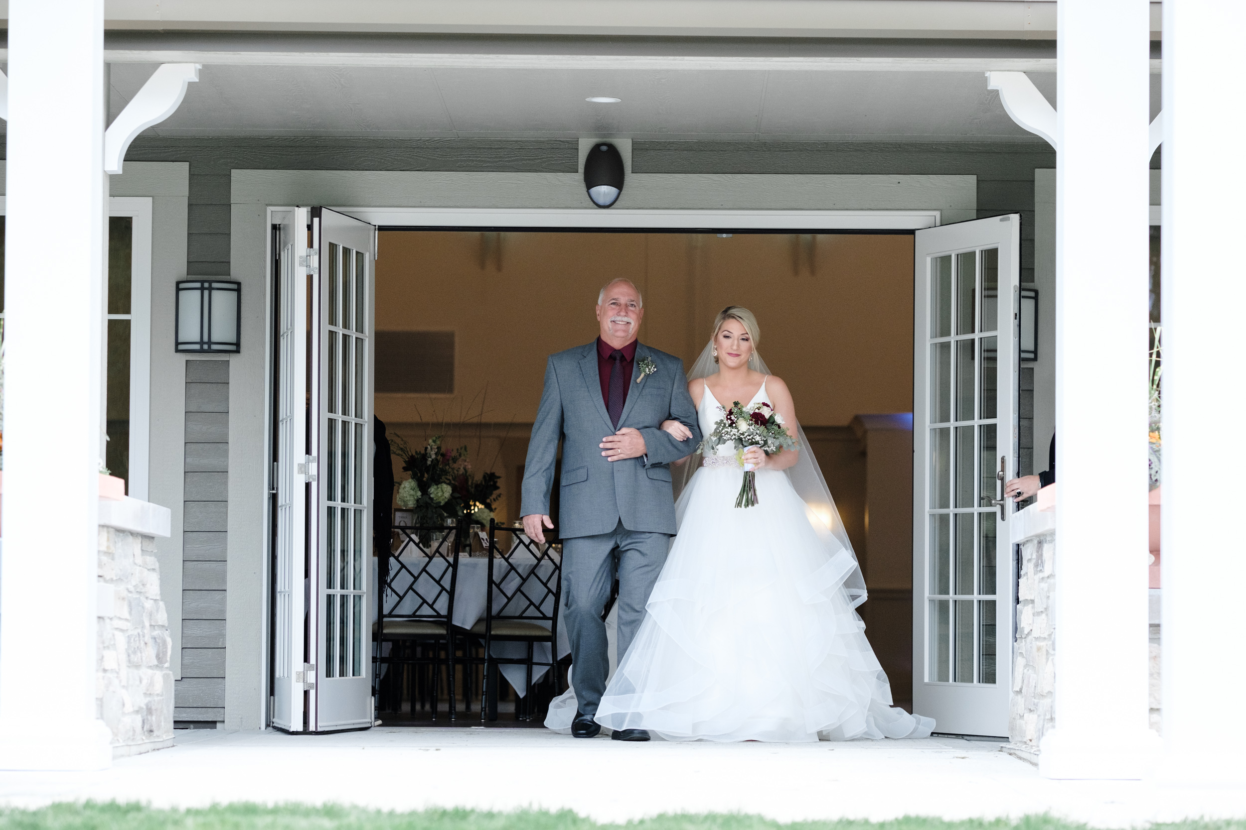 Bride walking out of Pavilion with Father at Rockford Bank and Trust Pavilion.