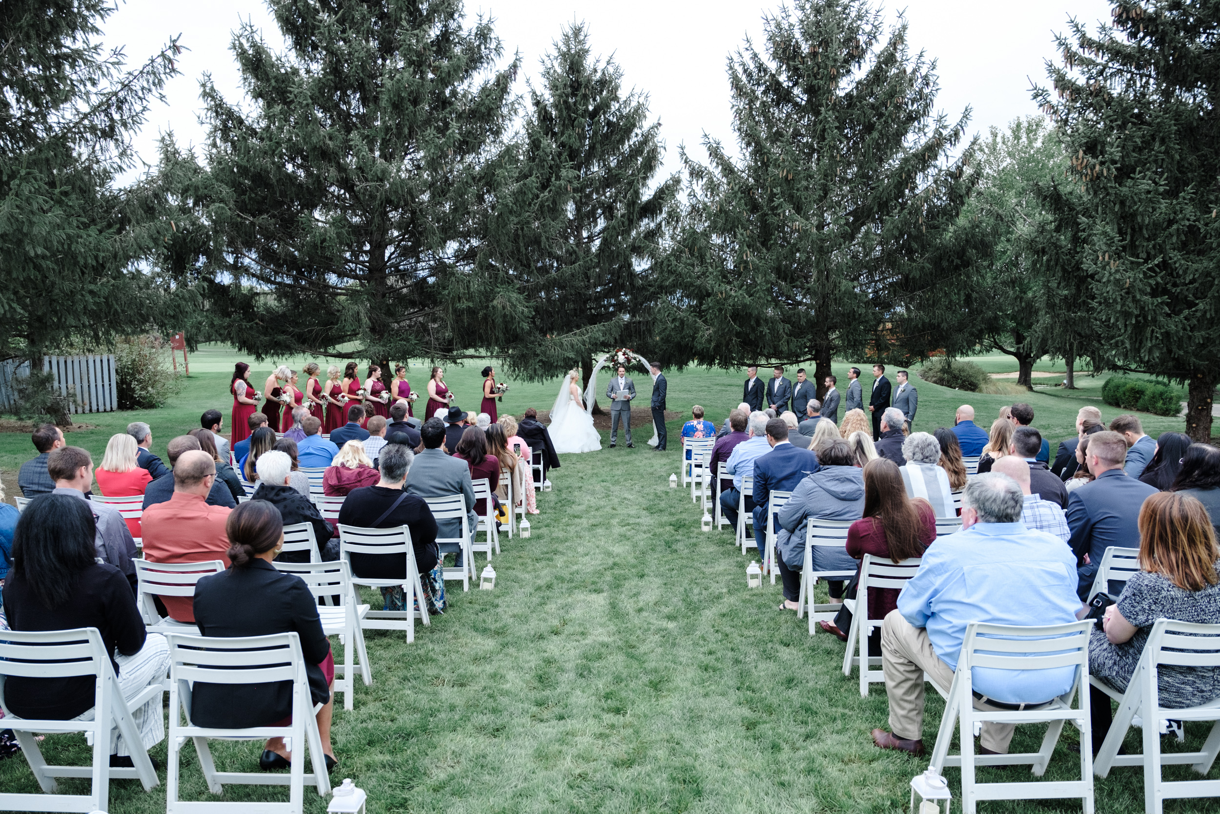 Outdoor summer wedding ceremony at Rockford Bank and Trust Pavilion.