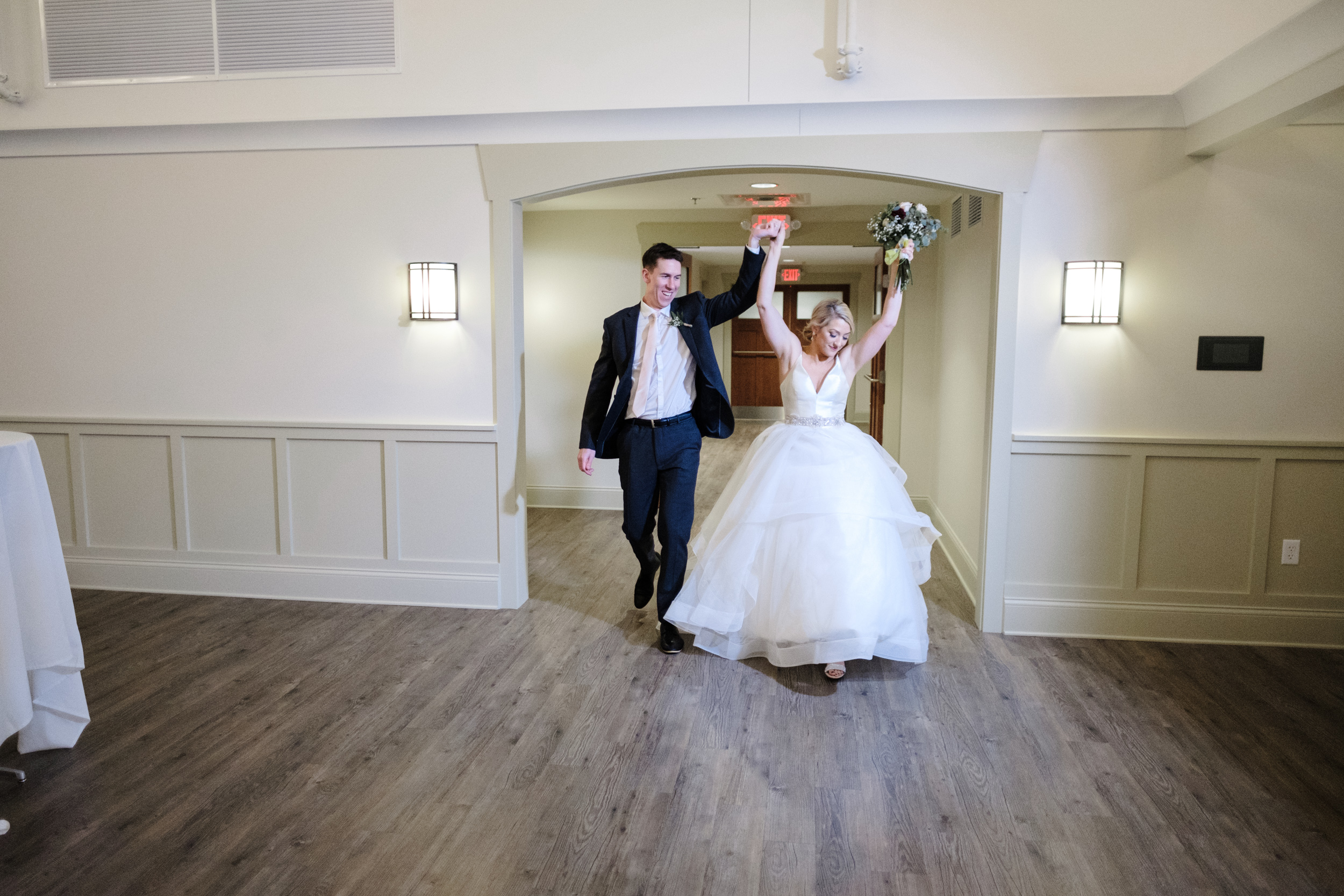 bride and groom make their grand entrance into the Rockford Bank and Trust Pavilion