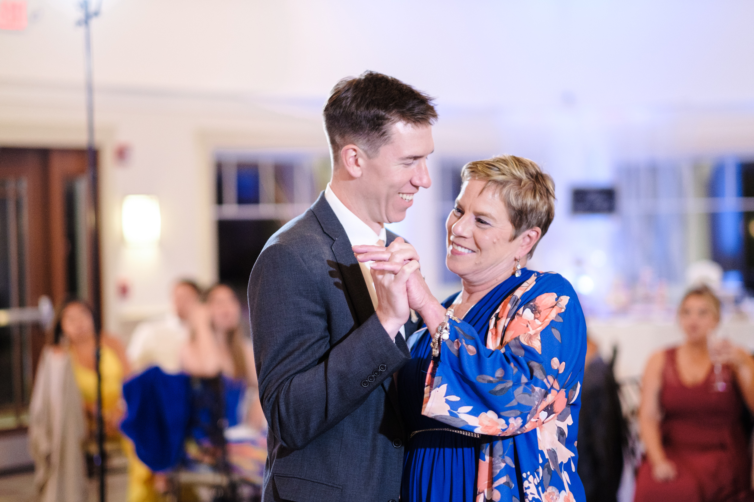 mother and son dance at wedding reception at the Rockford Bank and Trust Pavilion