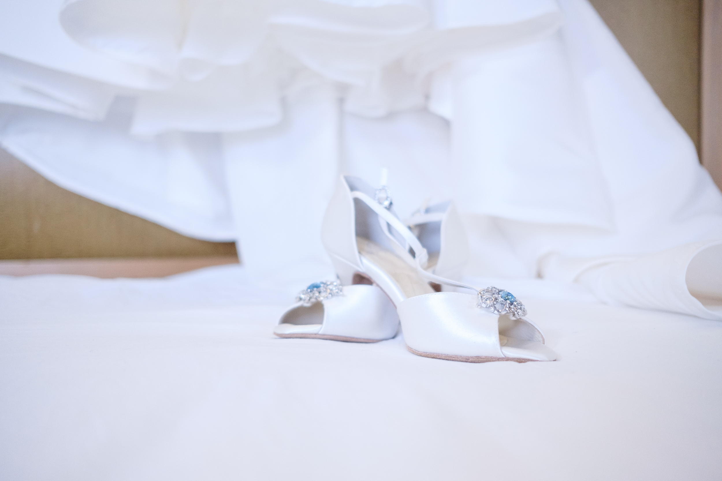 Brides shoes and dress before her wedding