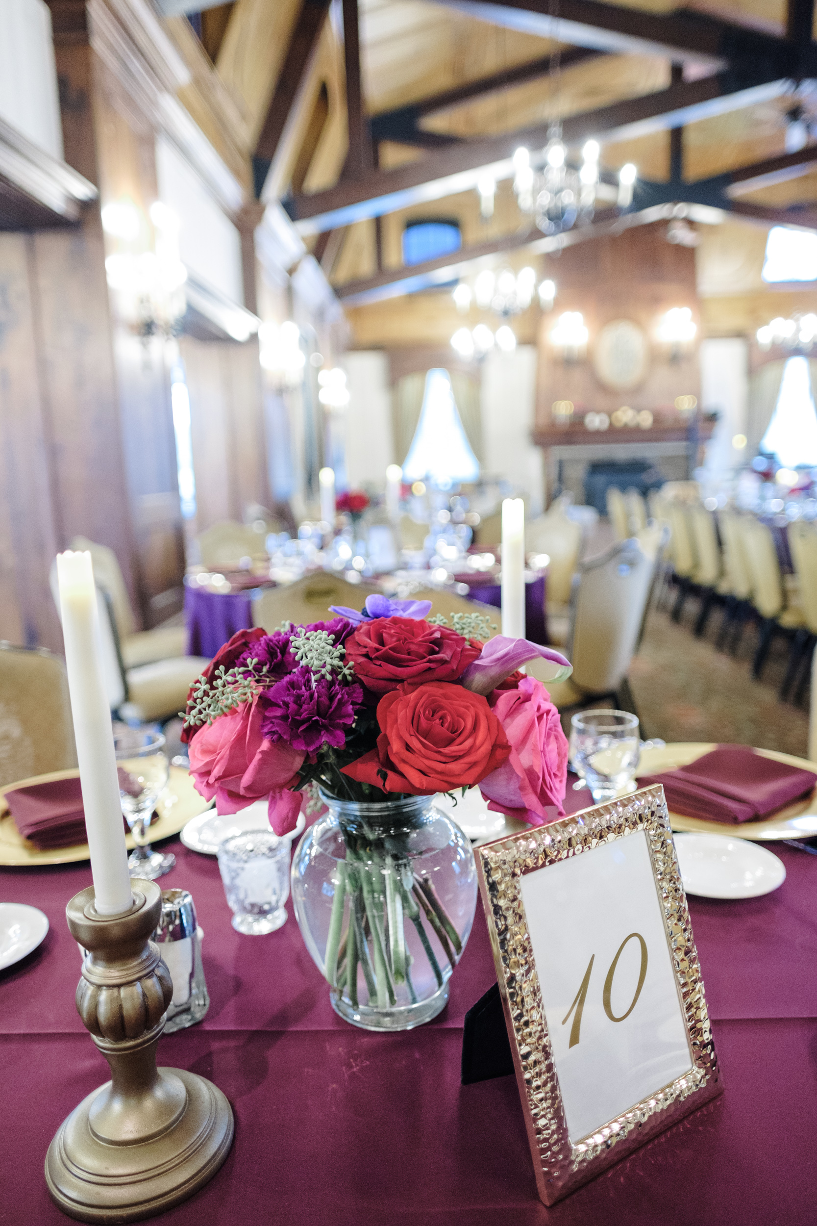 Lavender table cover with florals and candles at cog hill golf club in lemont for wedding