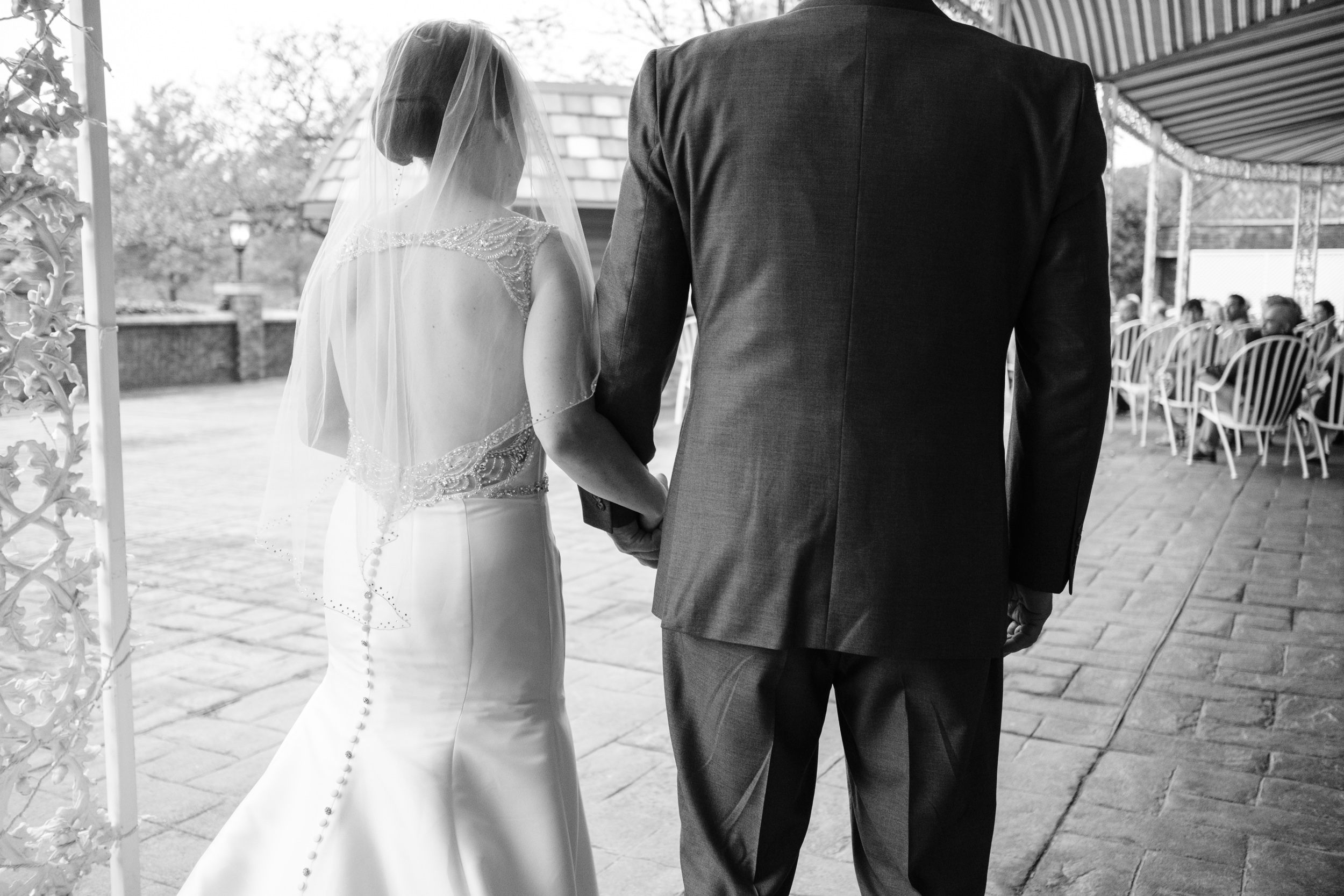 bride being walked down aisle by her father.