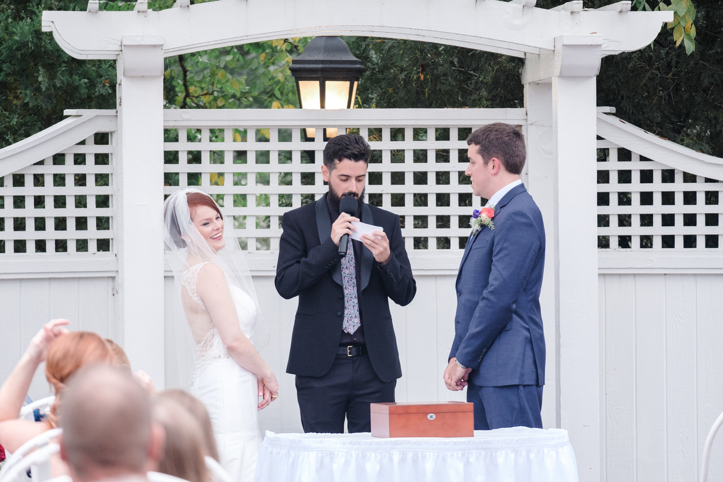 bride laughs during wedding ceremony by rockford's best wedding photographer