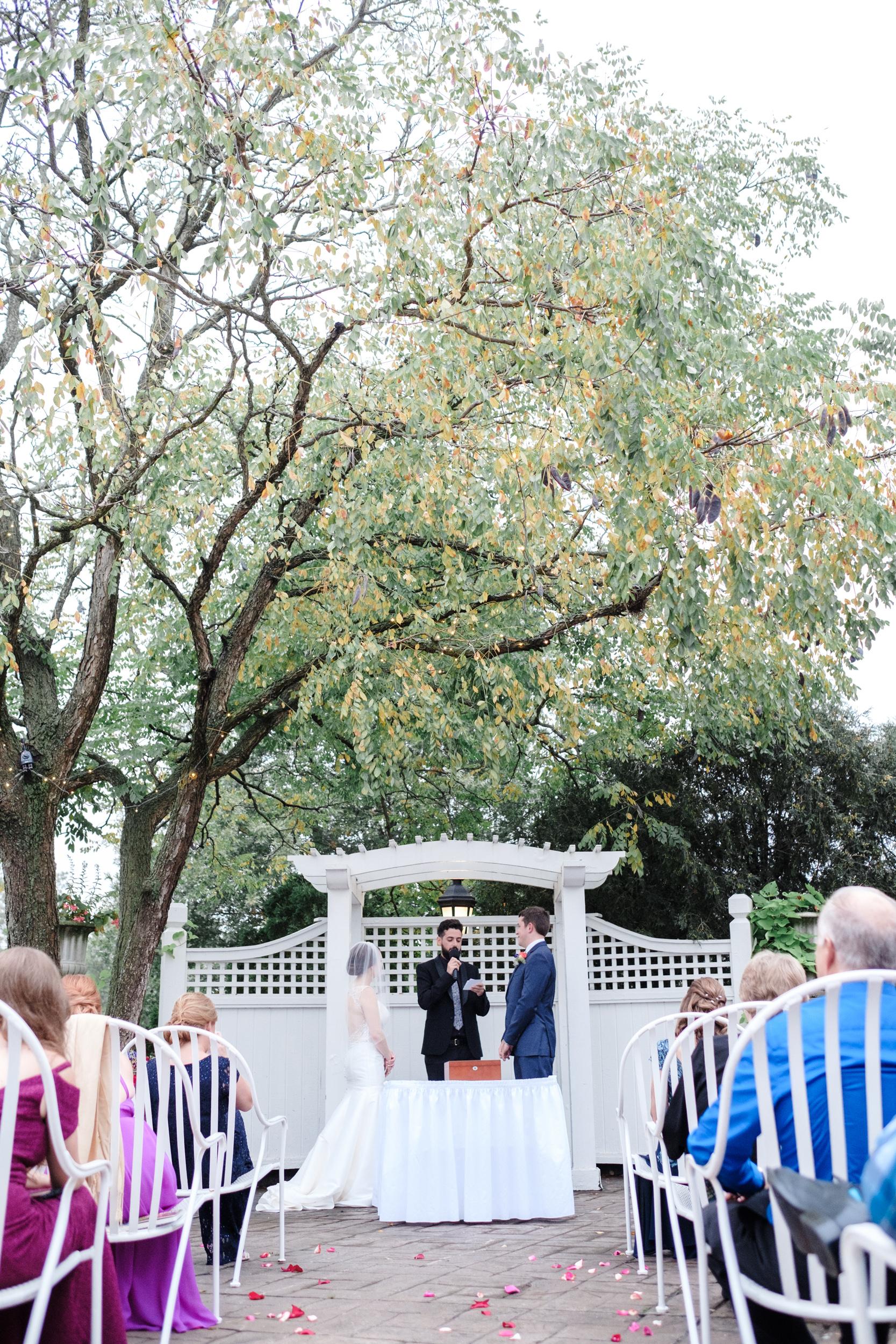outdoor wedding ceremony at cog hill golf club
