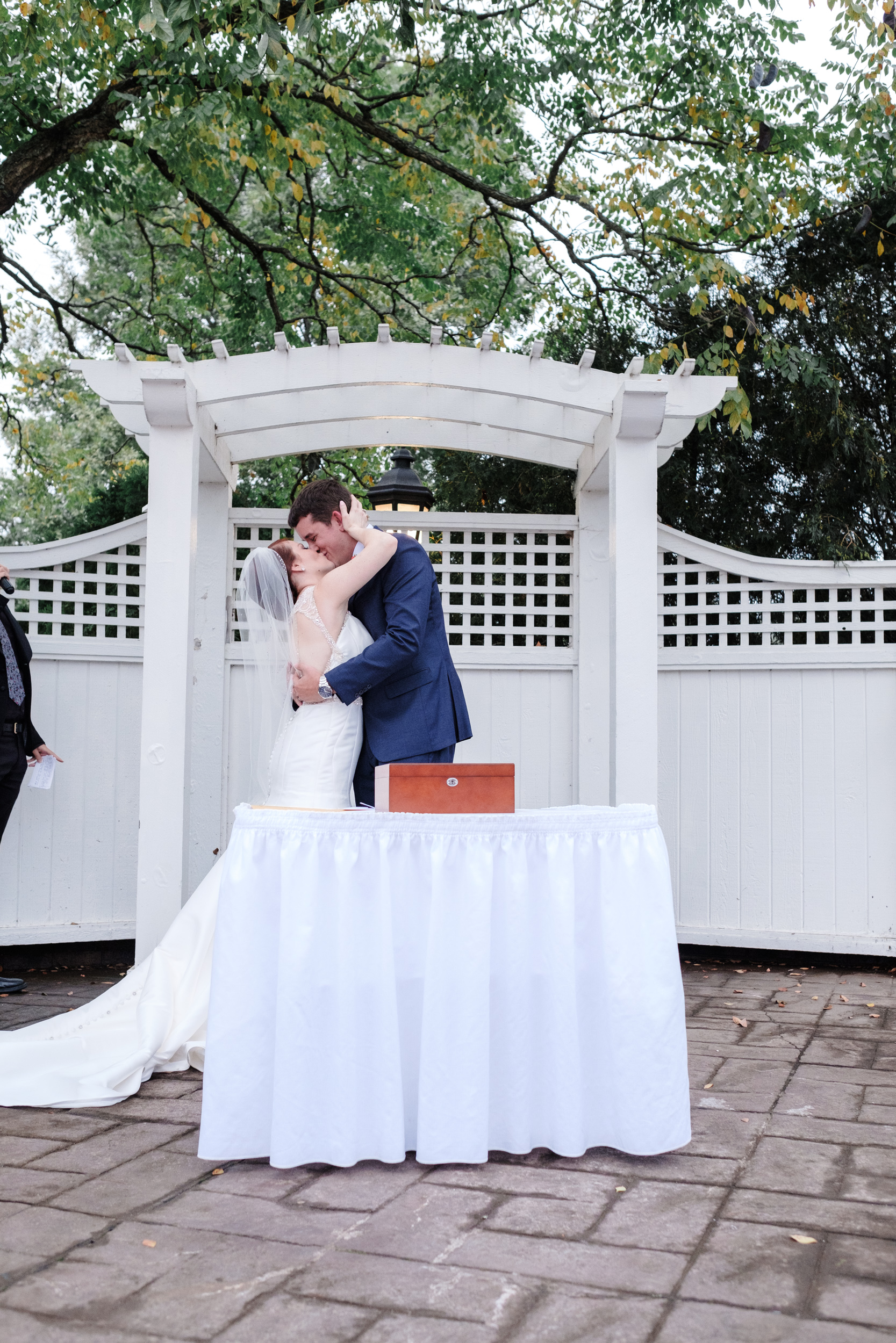 bride and groom first kiss at elegant wedding photogrphy