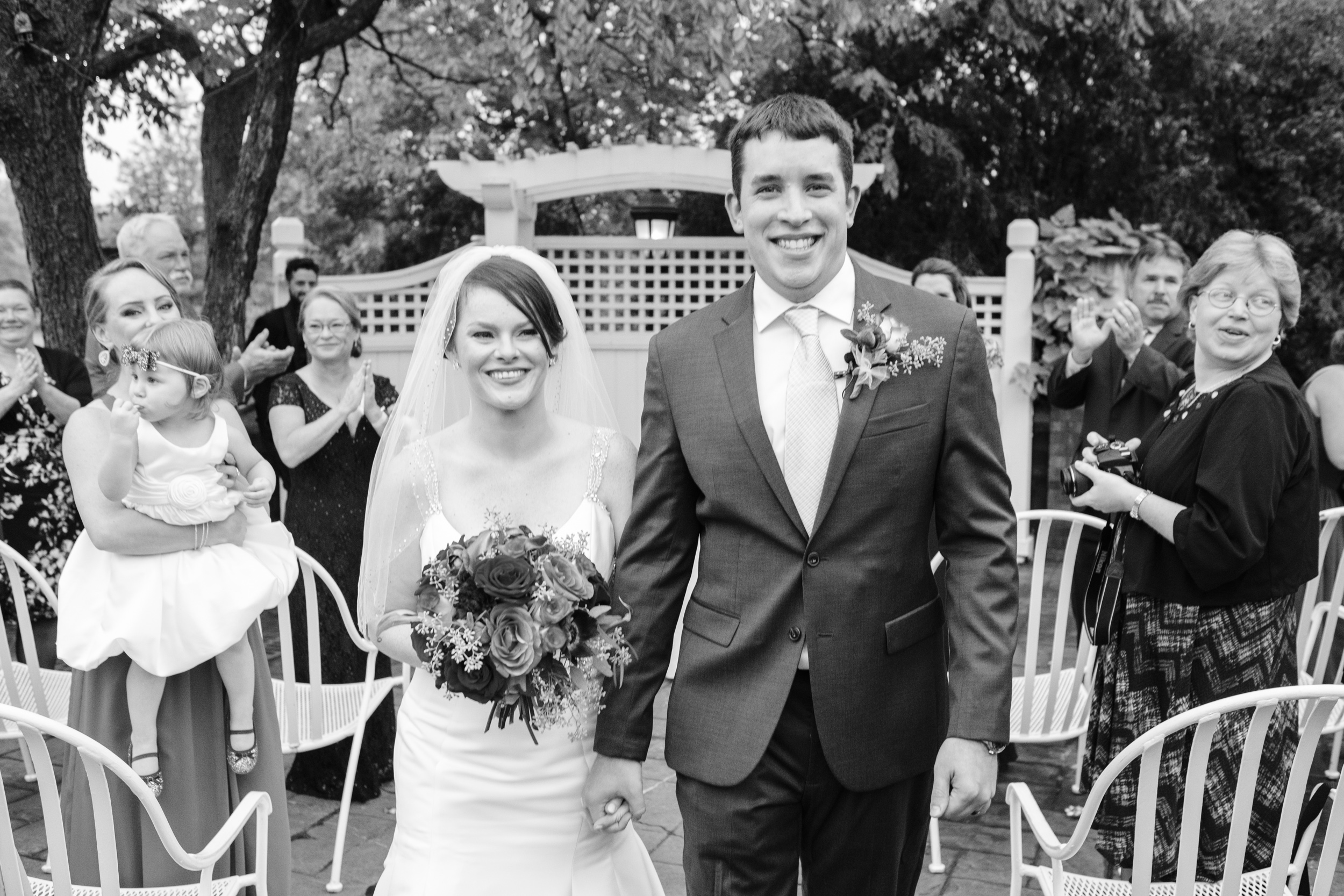 bride and groom candid smile as wedding ceremony finishes at cog hill
