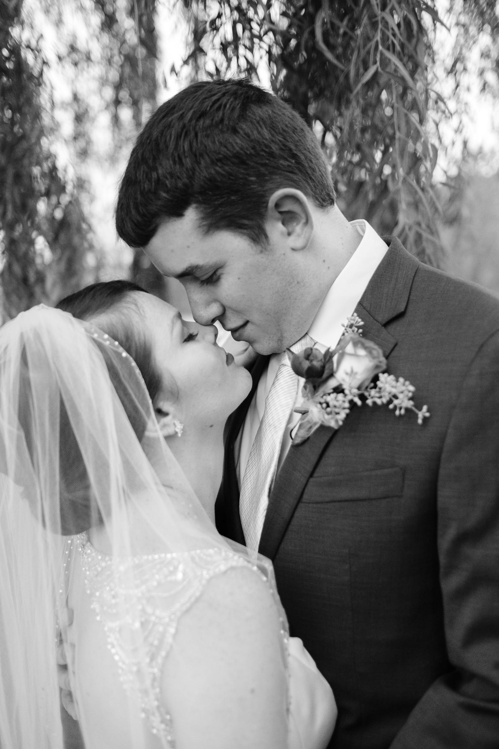 elegant wedding photography of couple embrace