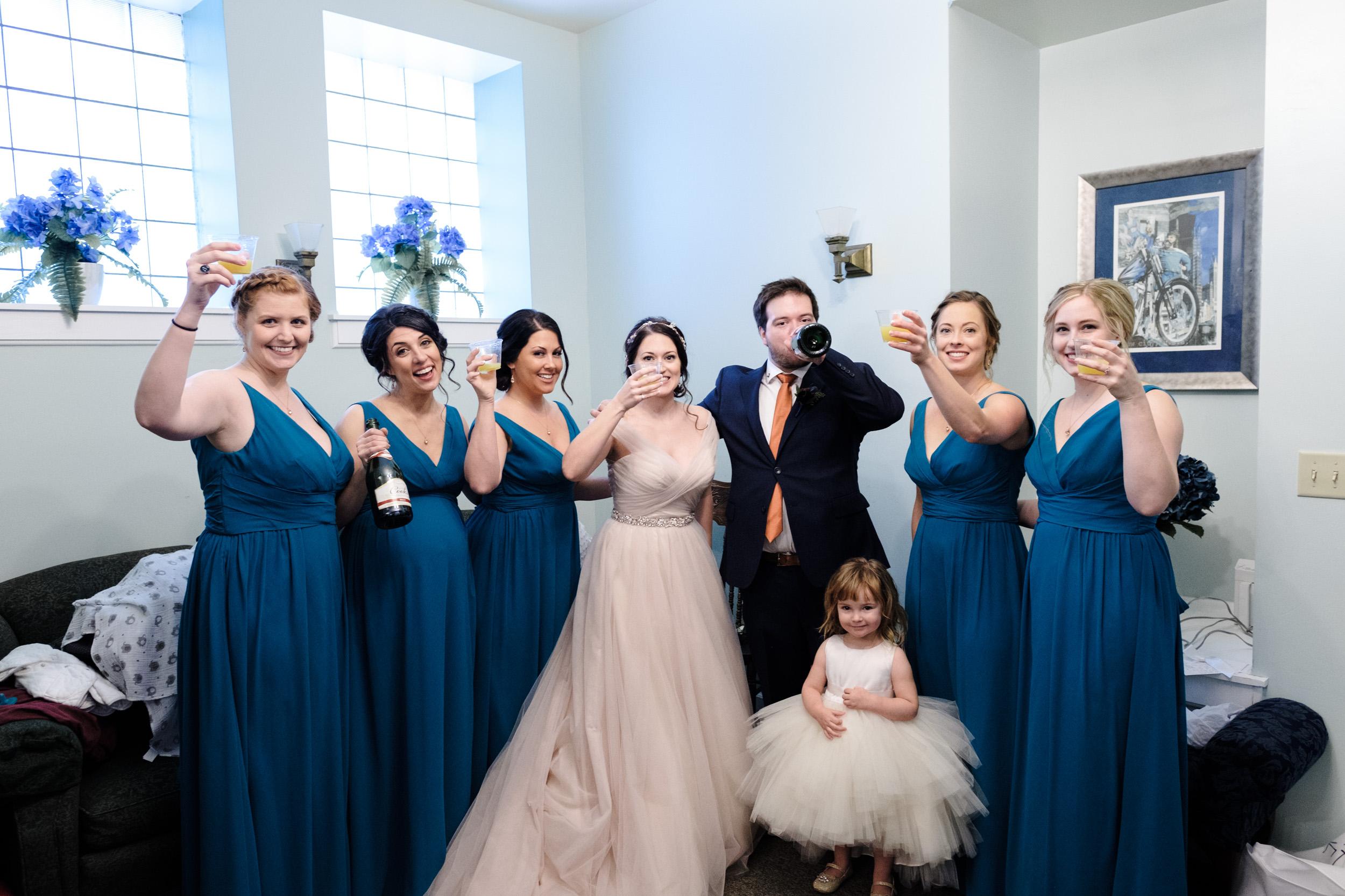 joyful wedding photo of bride and her bridesmaids