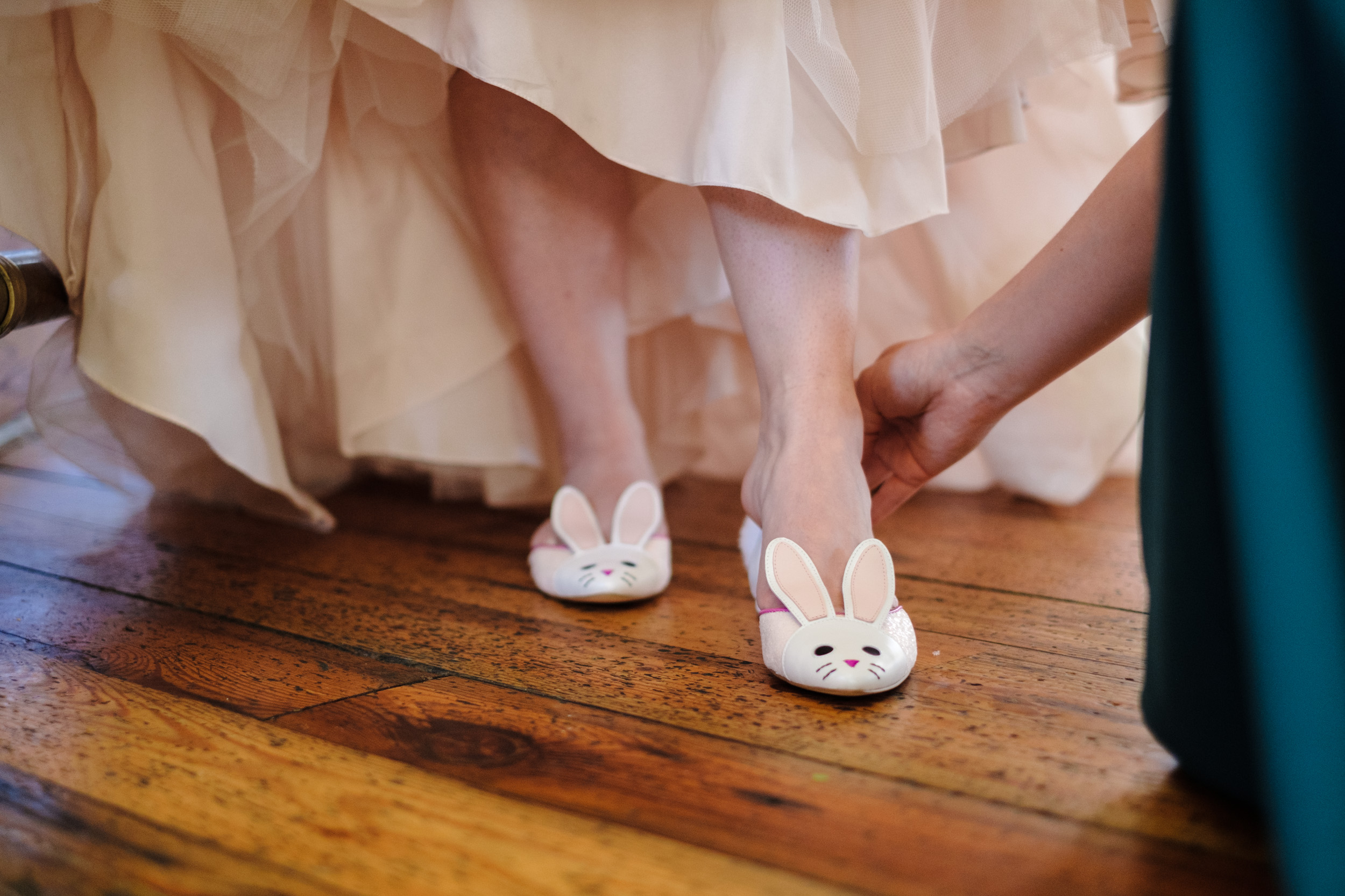 bride changes into bunny slippers immediately after wedding ceremony