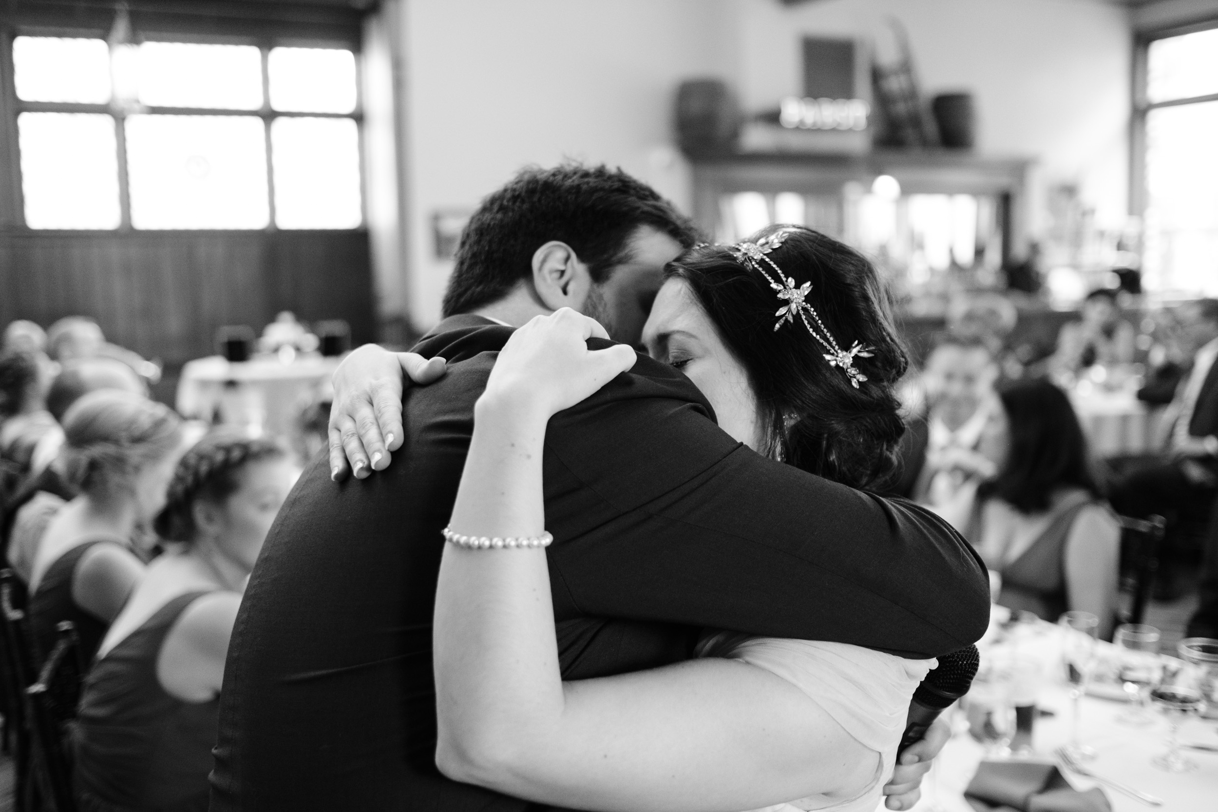 crying bride embraces husband during first dance.