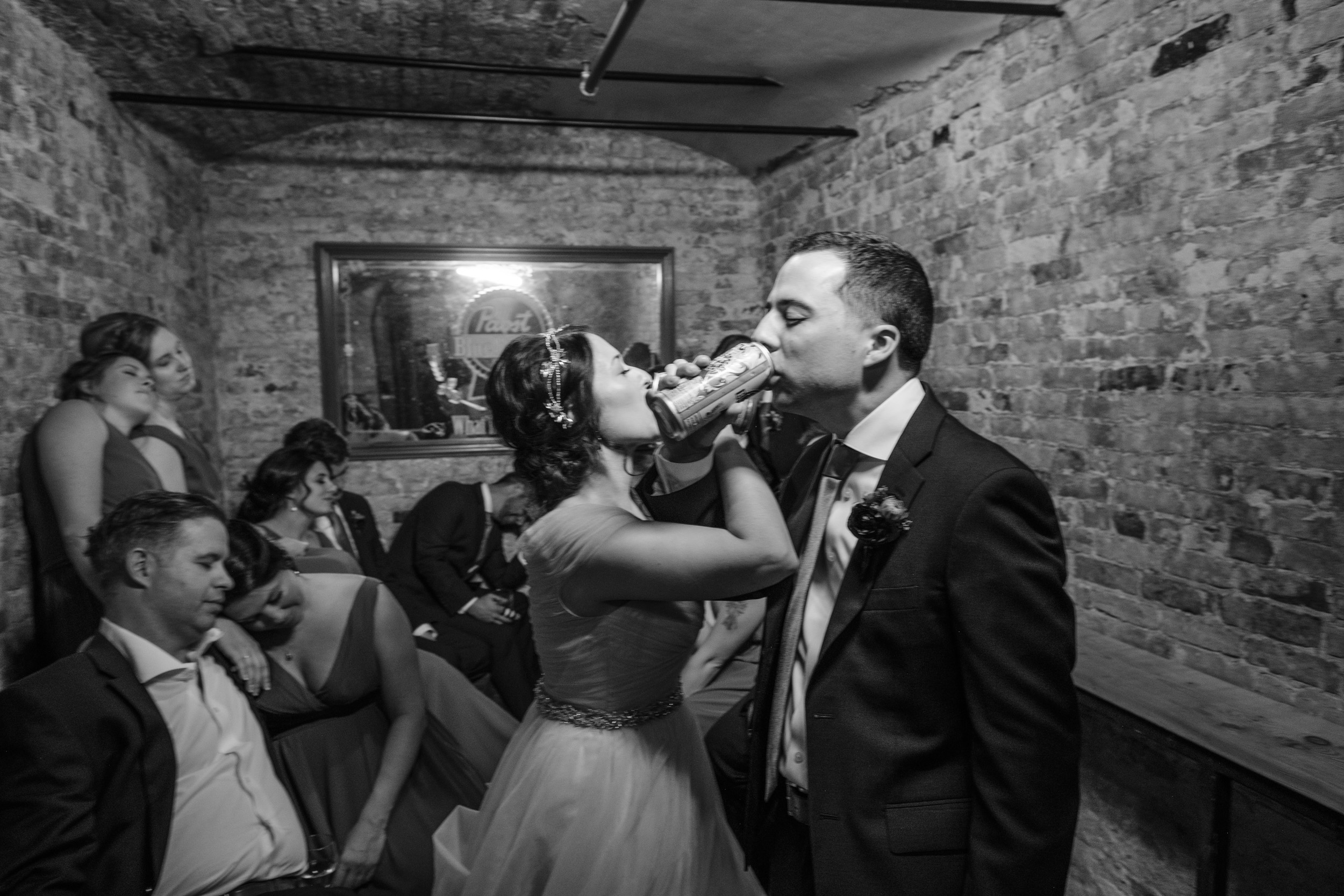 Bride and groom drinking Pabst Beer in jail cell.