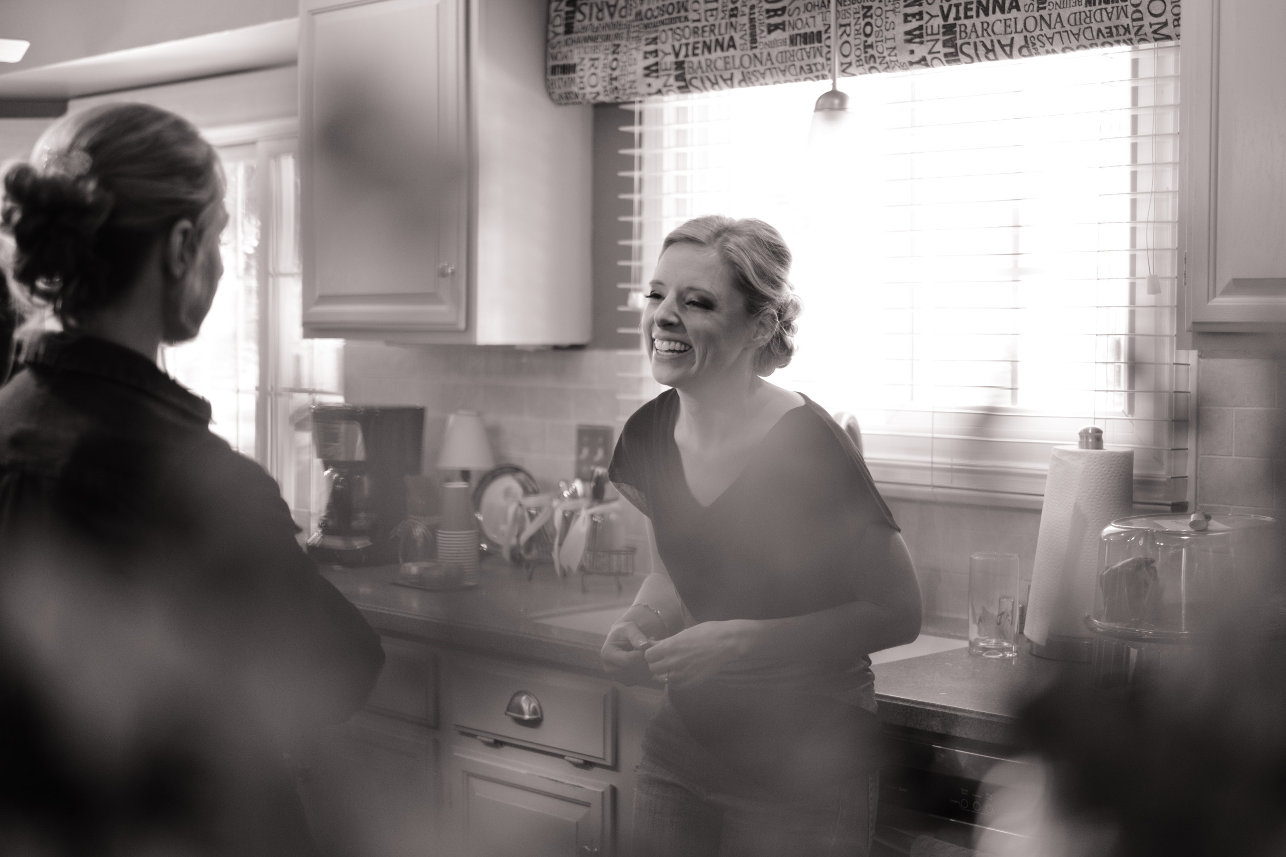 Wedding Photography bride getting ready black and white.  candid smiling laughing natural