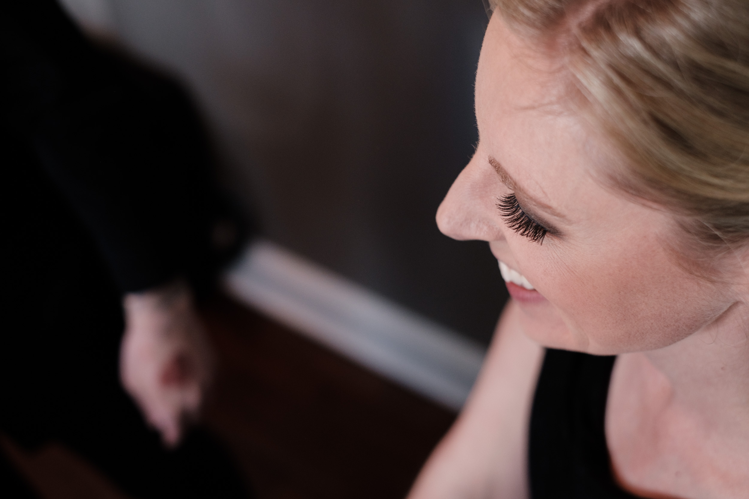 Wedding Photography bride getting ready blonde hair red lipstick candid smiling laughing natural