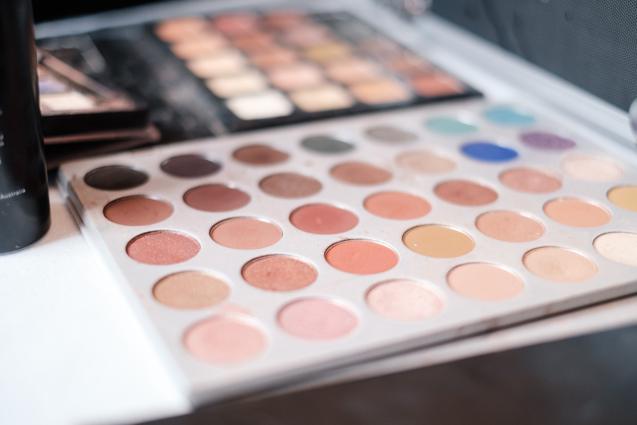 wedding photography of makeup palette while bride gets ready
