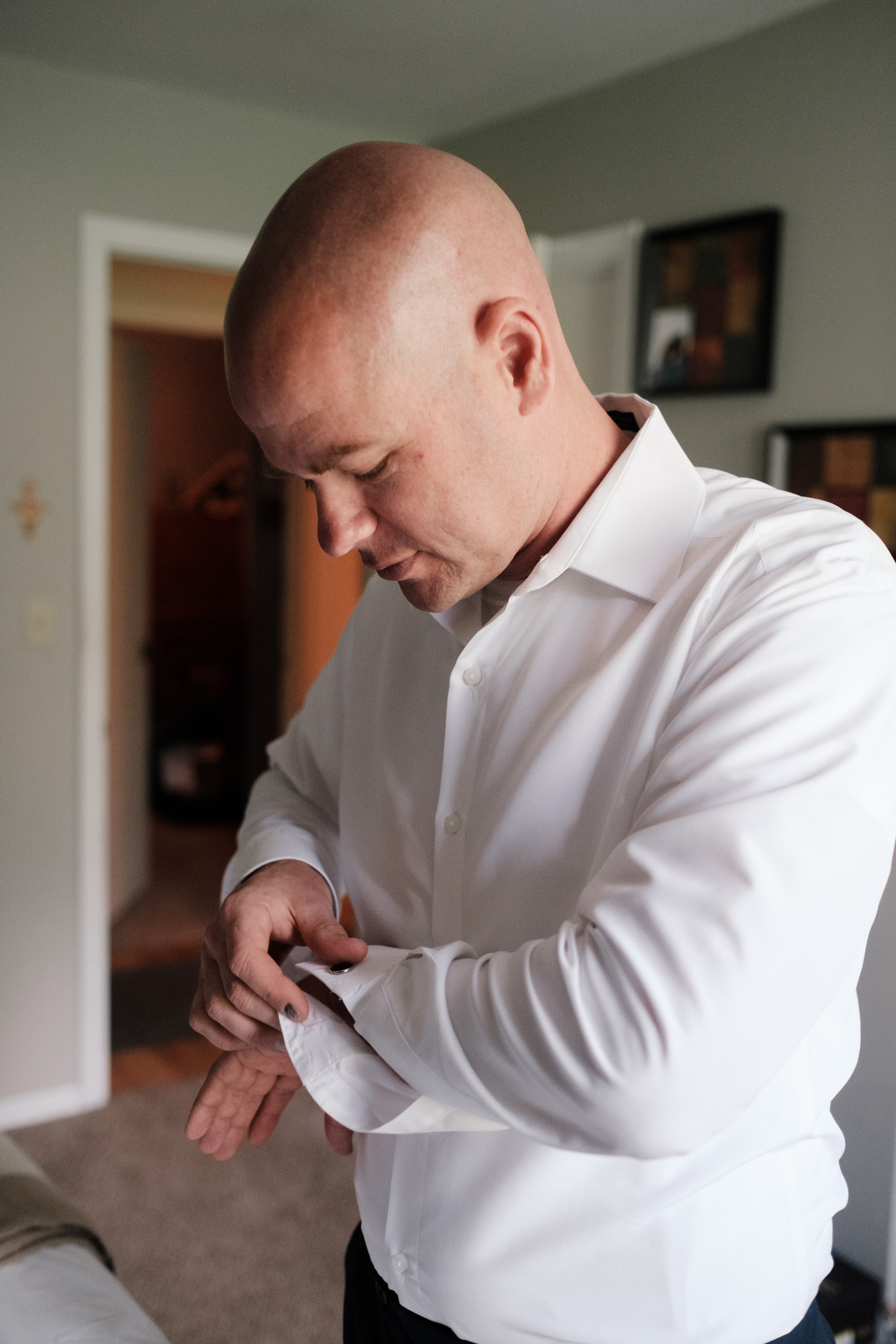 groom getting ready at home in crystal lake on wedding day by rockford photographer