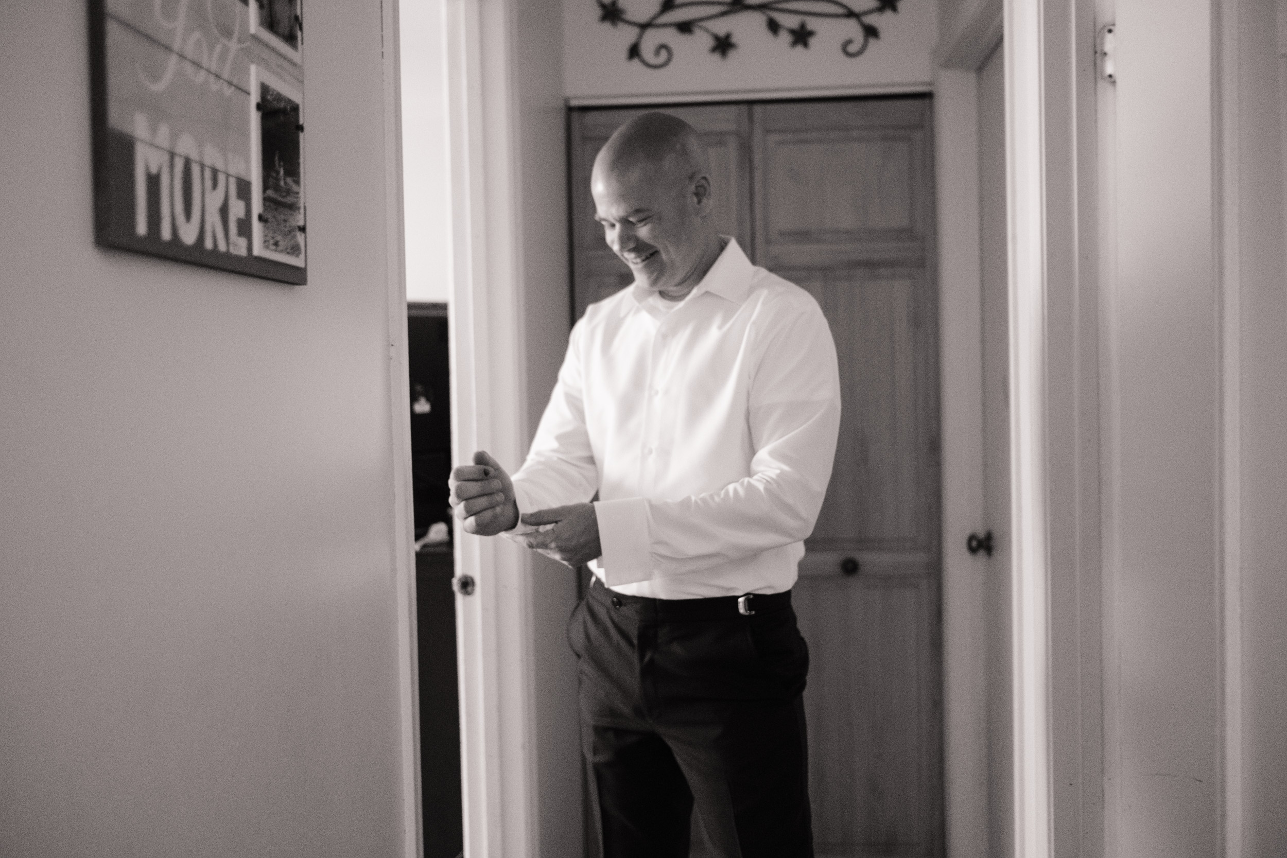 Groom getting ready wedding day black and white the brix