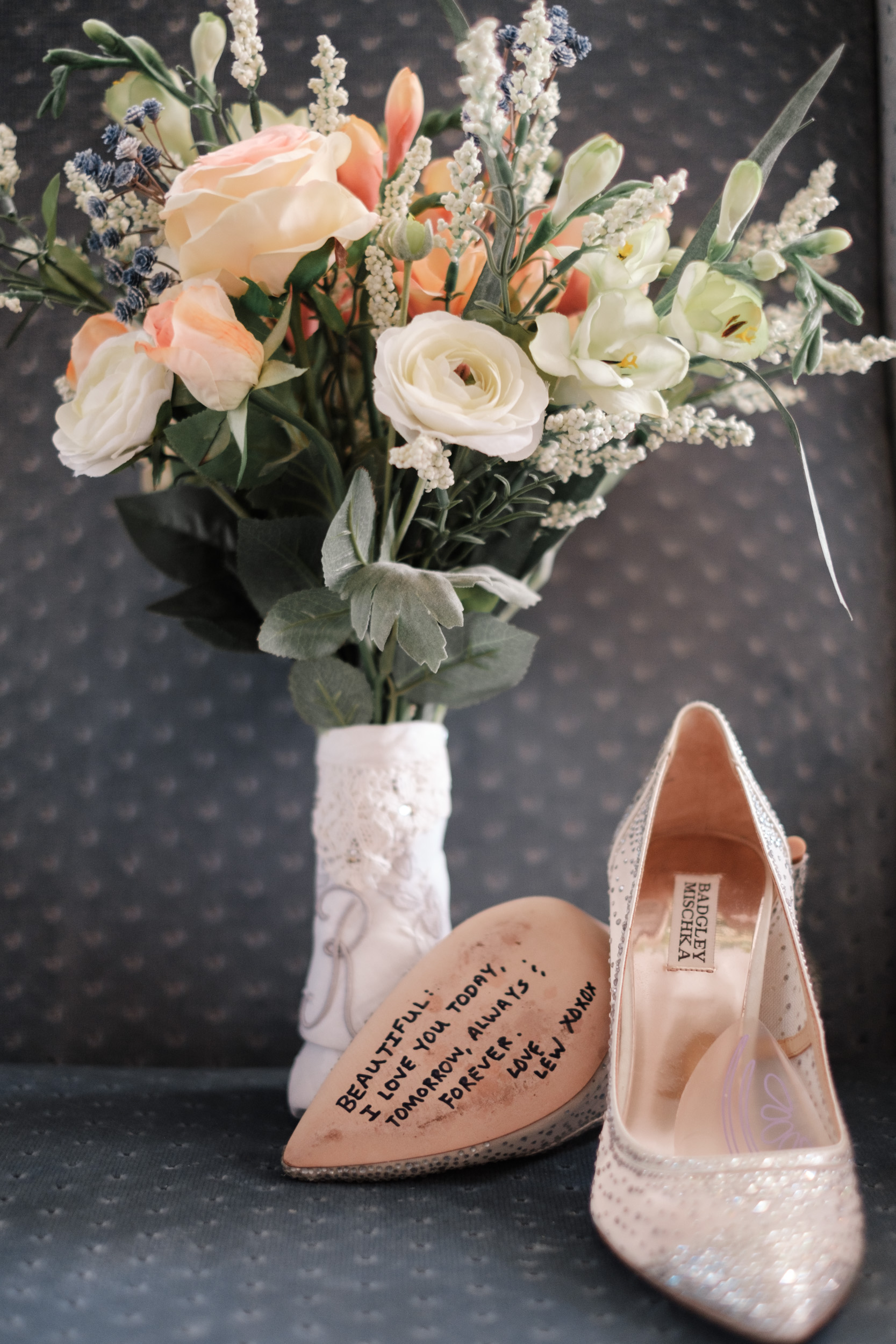 candid love note written on bride heels by groom on wedding day in crystal lake