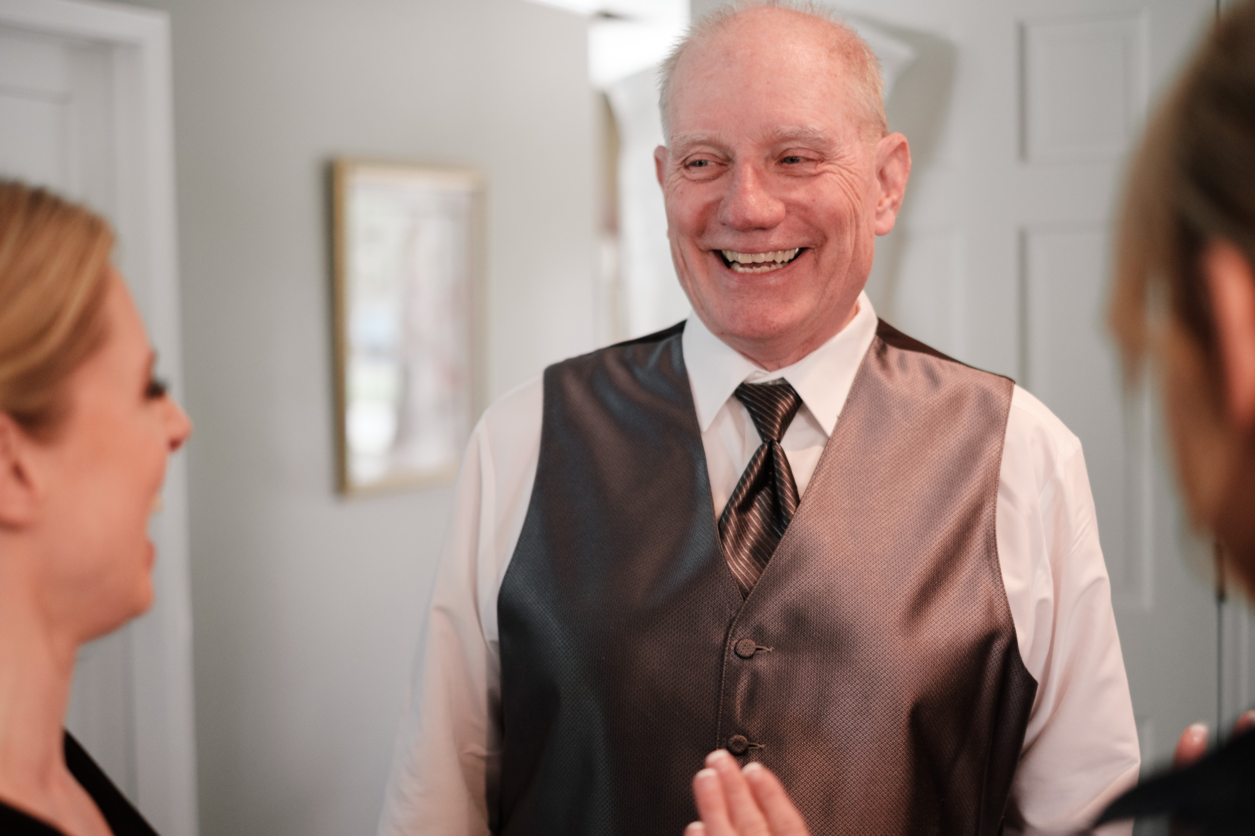 father of bride smiling on wedding day