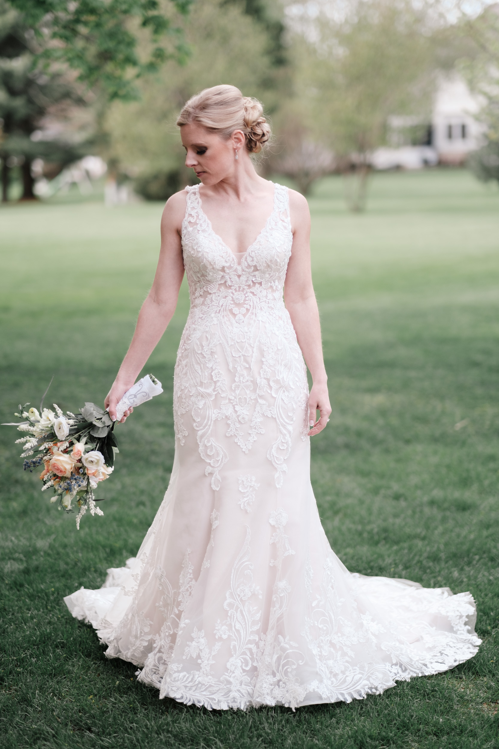 bridal portrait of blonde bride on wedding day open back wedding dress