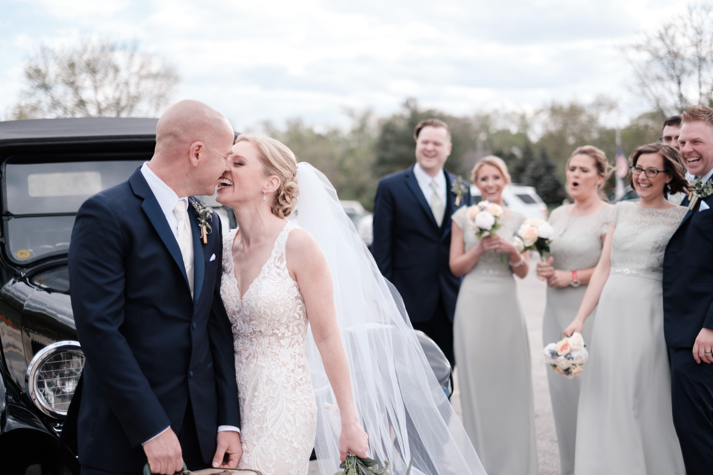 natural portrait of bride and groom kissing on wedding day at the brix