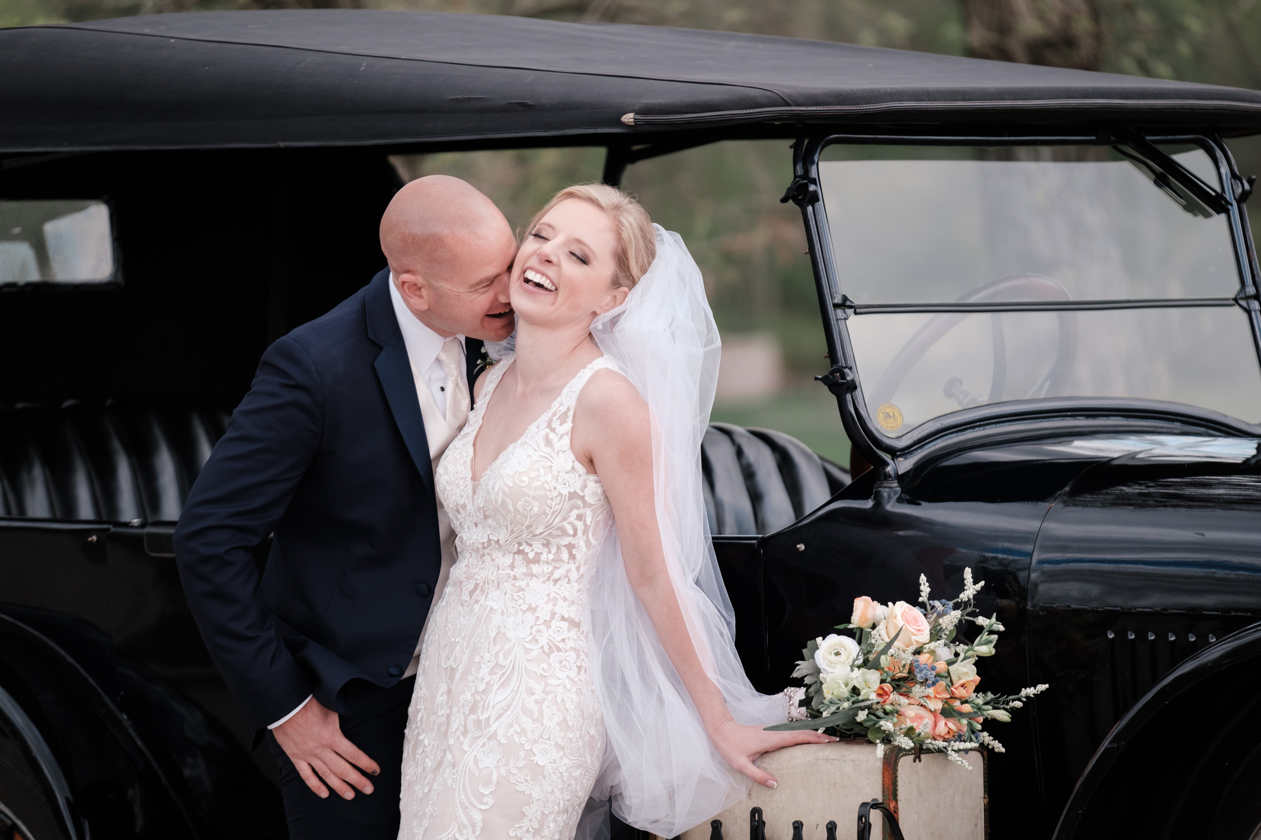 natural portrait of bride and groom laughing on wedding day at the brix
